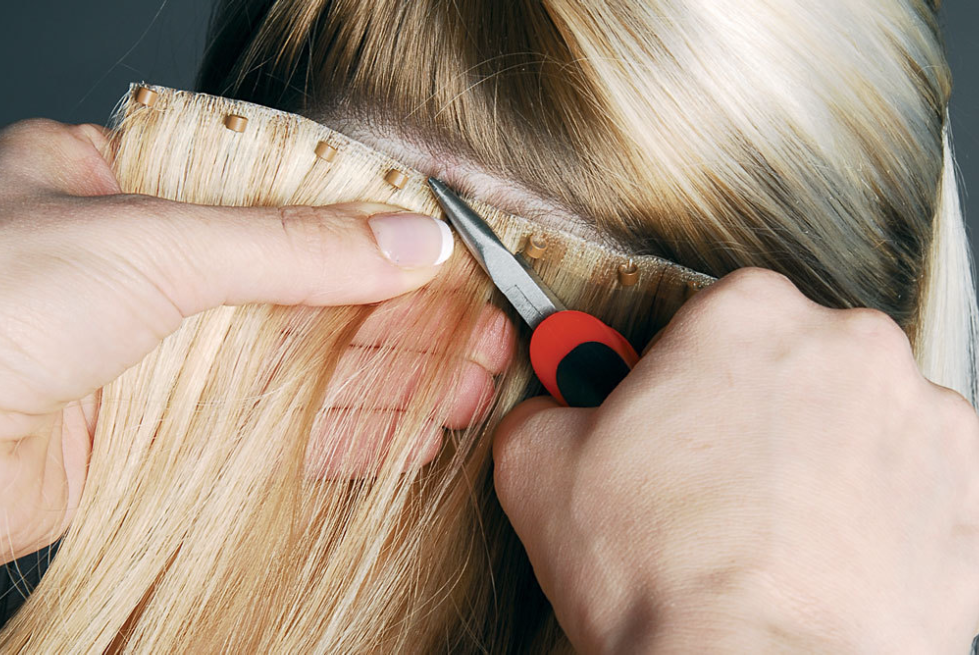 Micro Link Installation - Hair extensions is looped through the natural hair and then clamped to secure the hair.