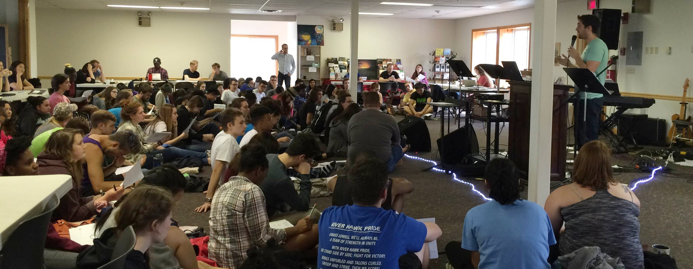 Zack leading 115 students at Summit on how to make good, God centered plans for leading a Bible study small group.