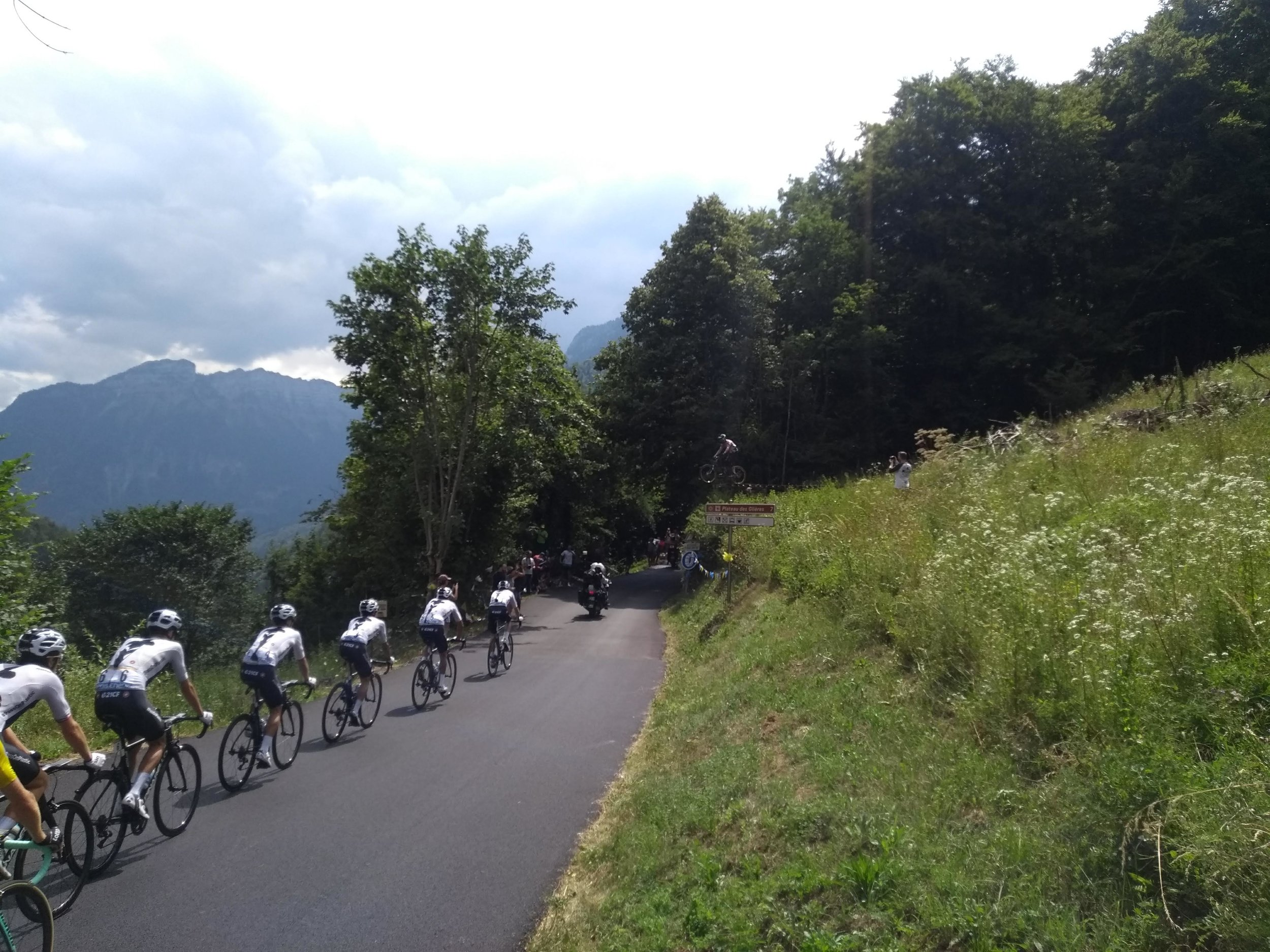 Some nut-job jumping over Team Sky as they lead the Peloton up to the plateau