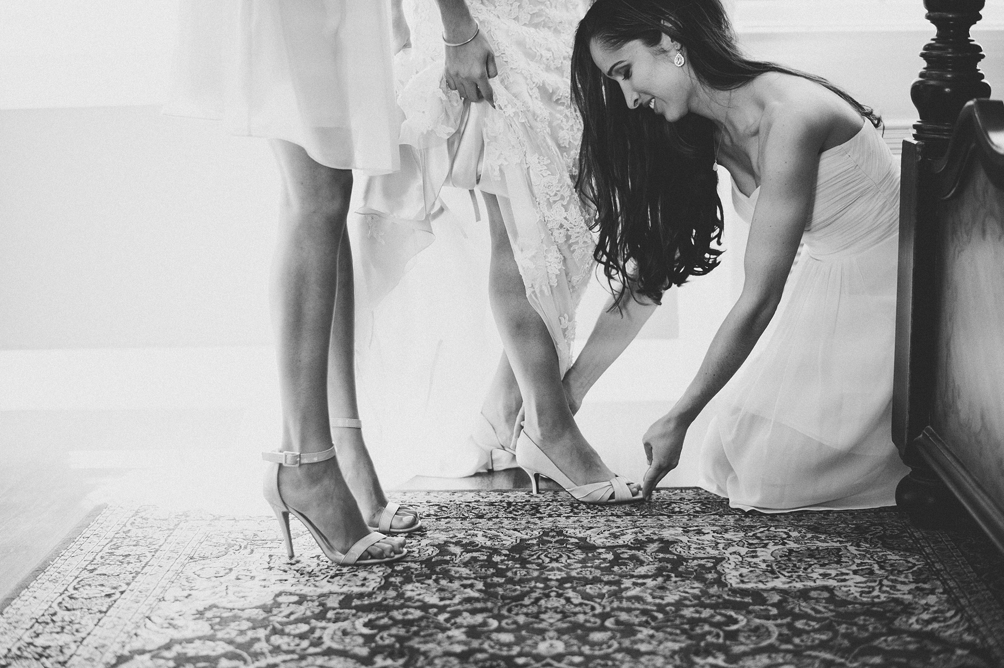 22-putting-on-brides-shoes.jpg
