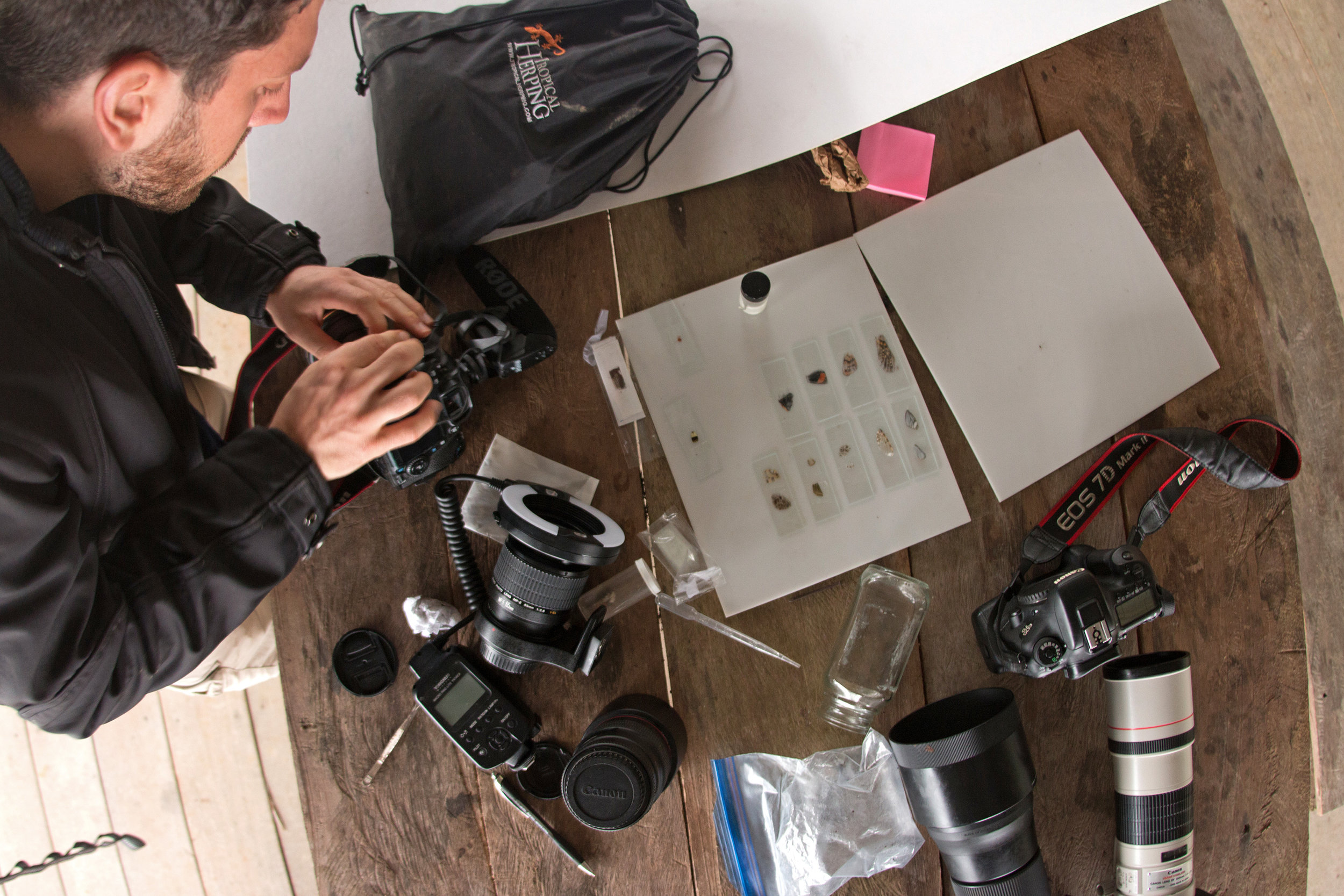 At our remote outpost in Sumaco, Ecuador, tinkering with my camera to photograph insects and butterfly wing scales.