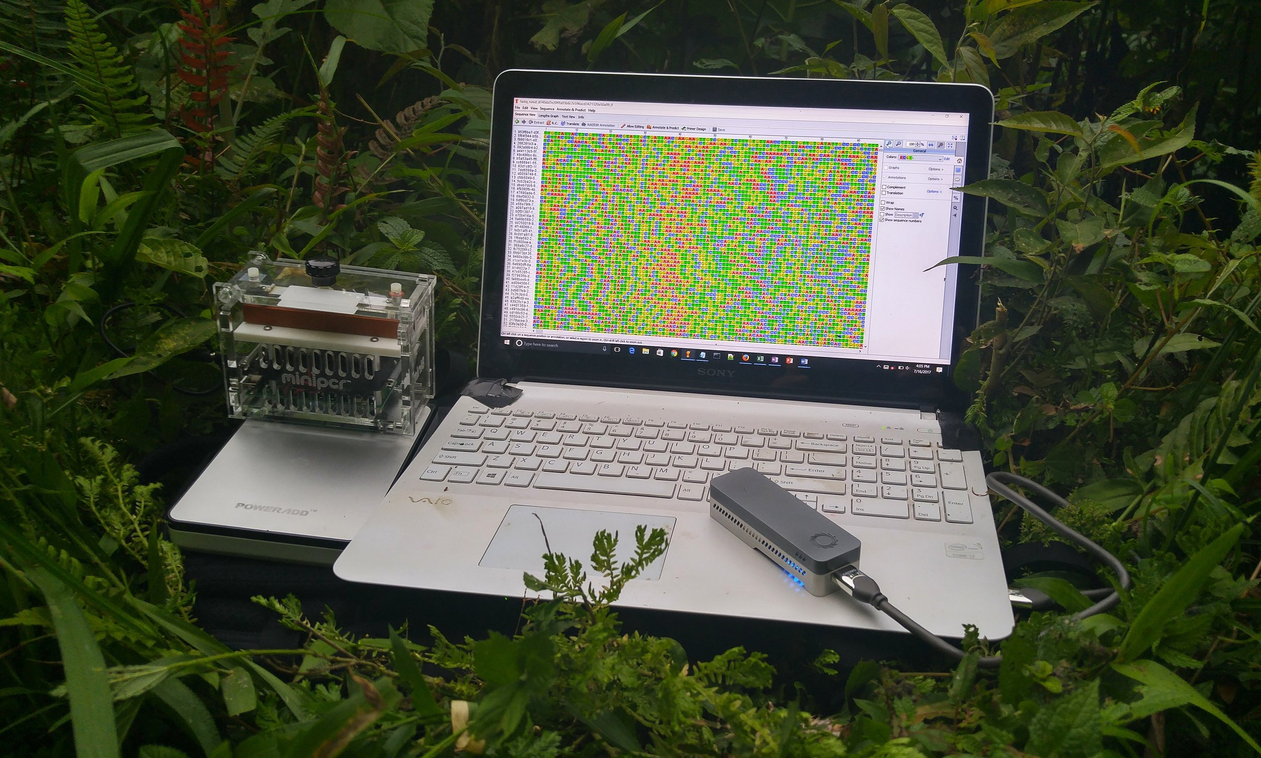Components of the portable lab used on the trip. Left to right: miniPCR sitting atop the Poweradd battery, Vaio laptop with Geneious pro software to visualize sequence data, and the ONT MinION sequencer powered by the laptop.