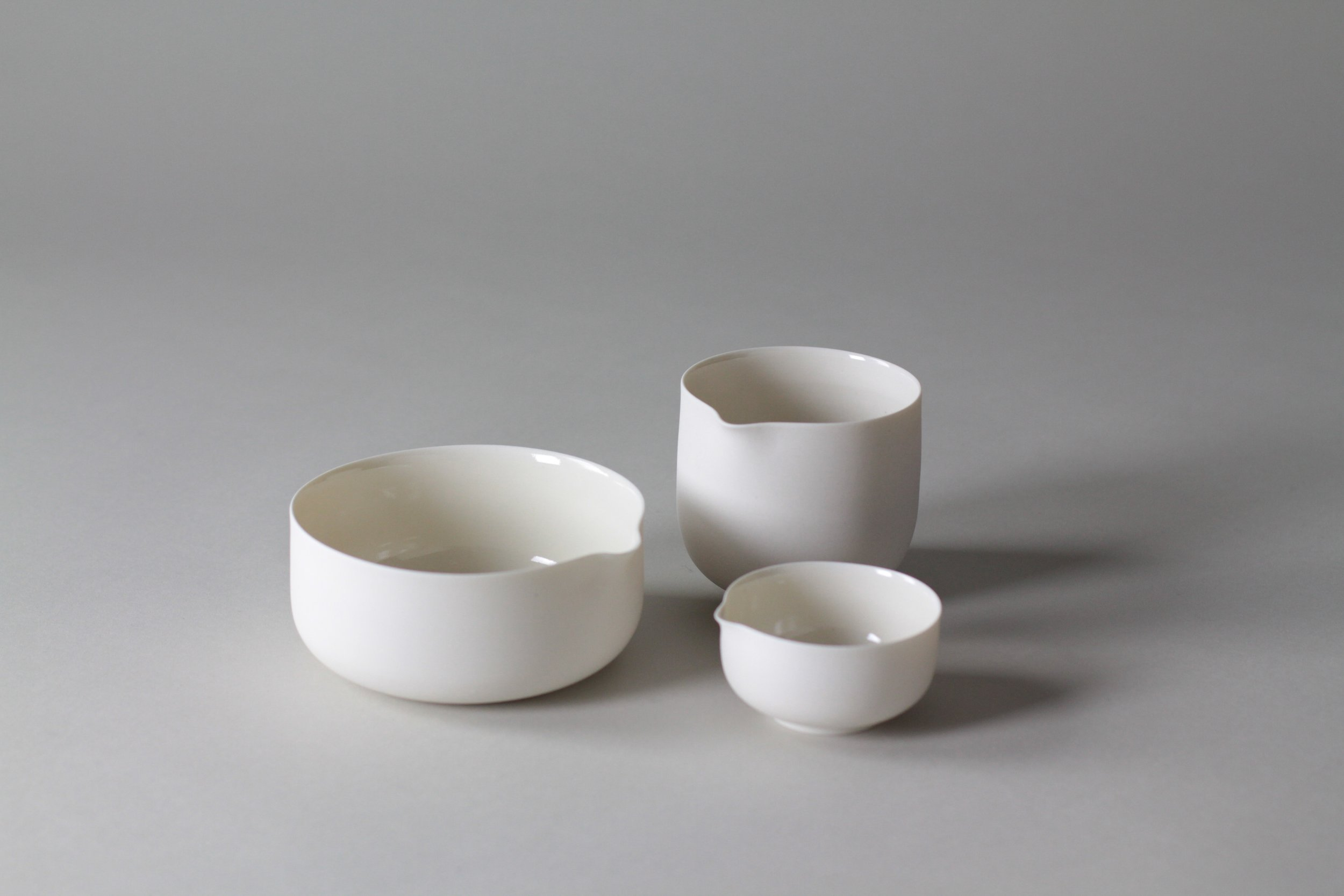 Ceramic tableware pourers and bowl by Lilith Rockett, Portland, Oregon