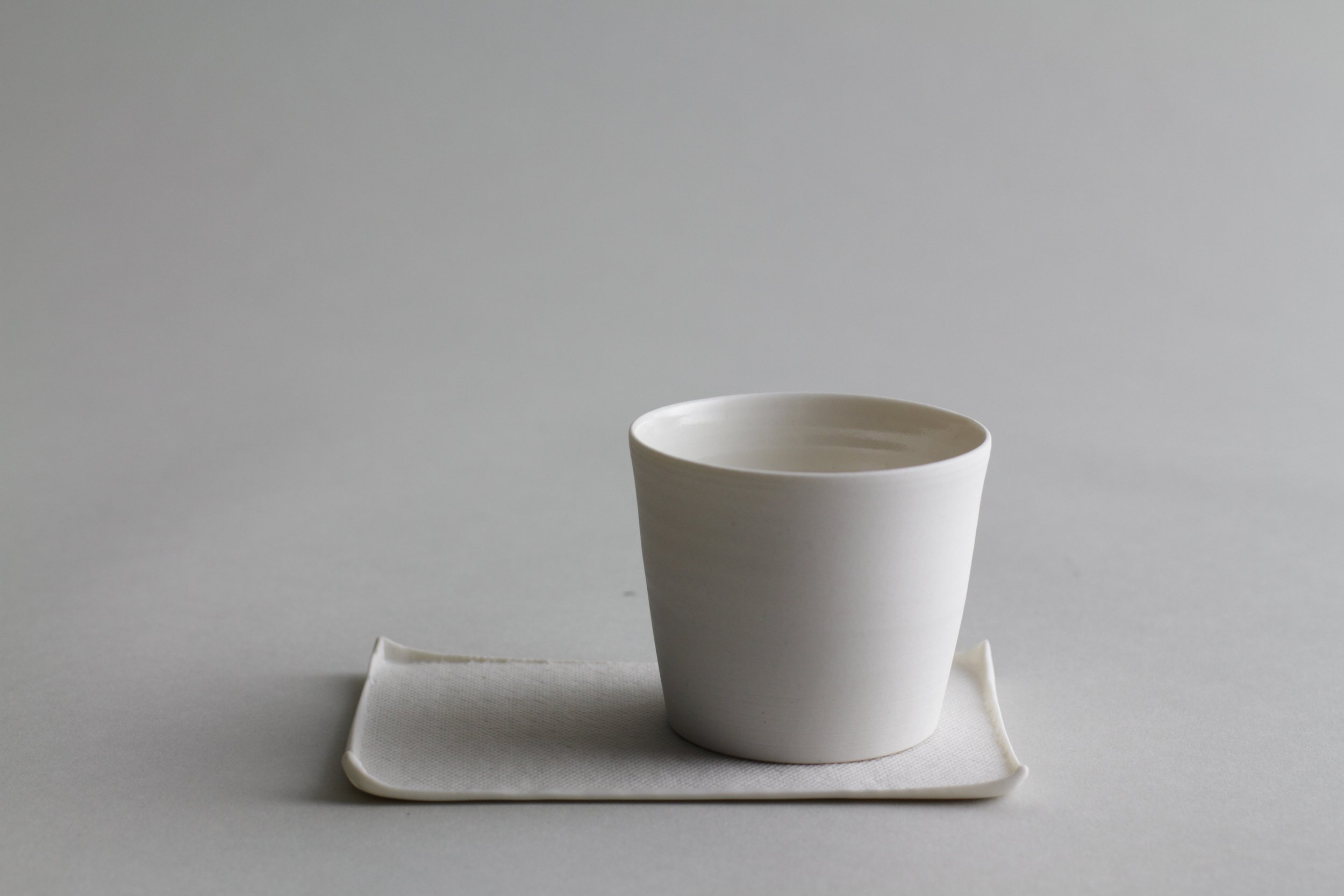 Ceramic tea cup and canvas-textured tray made by Lilith Rockett, Portland, Oregon