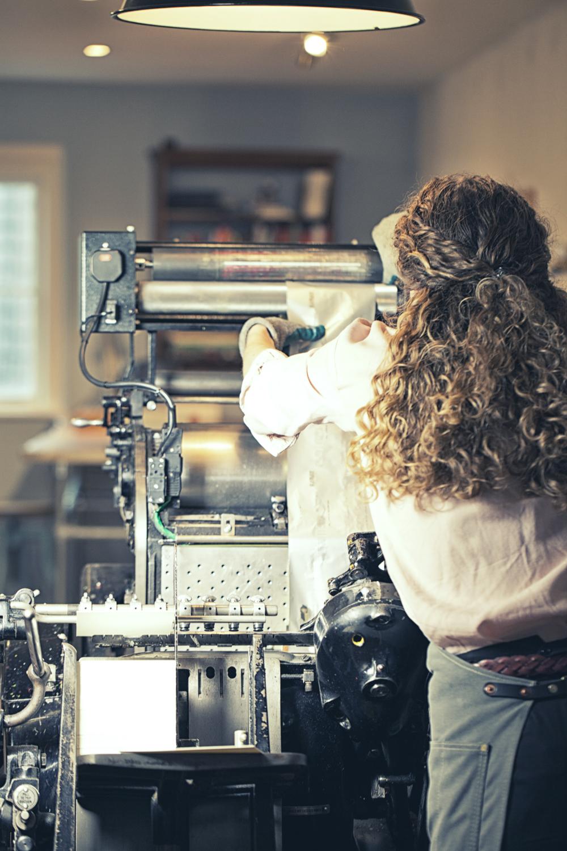 Zoe working the Heidelberg letterpress @ Meticulous Ink