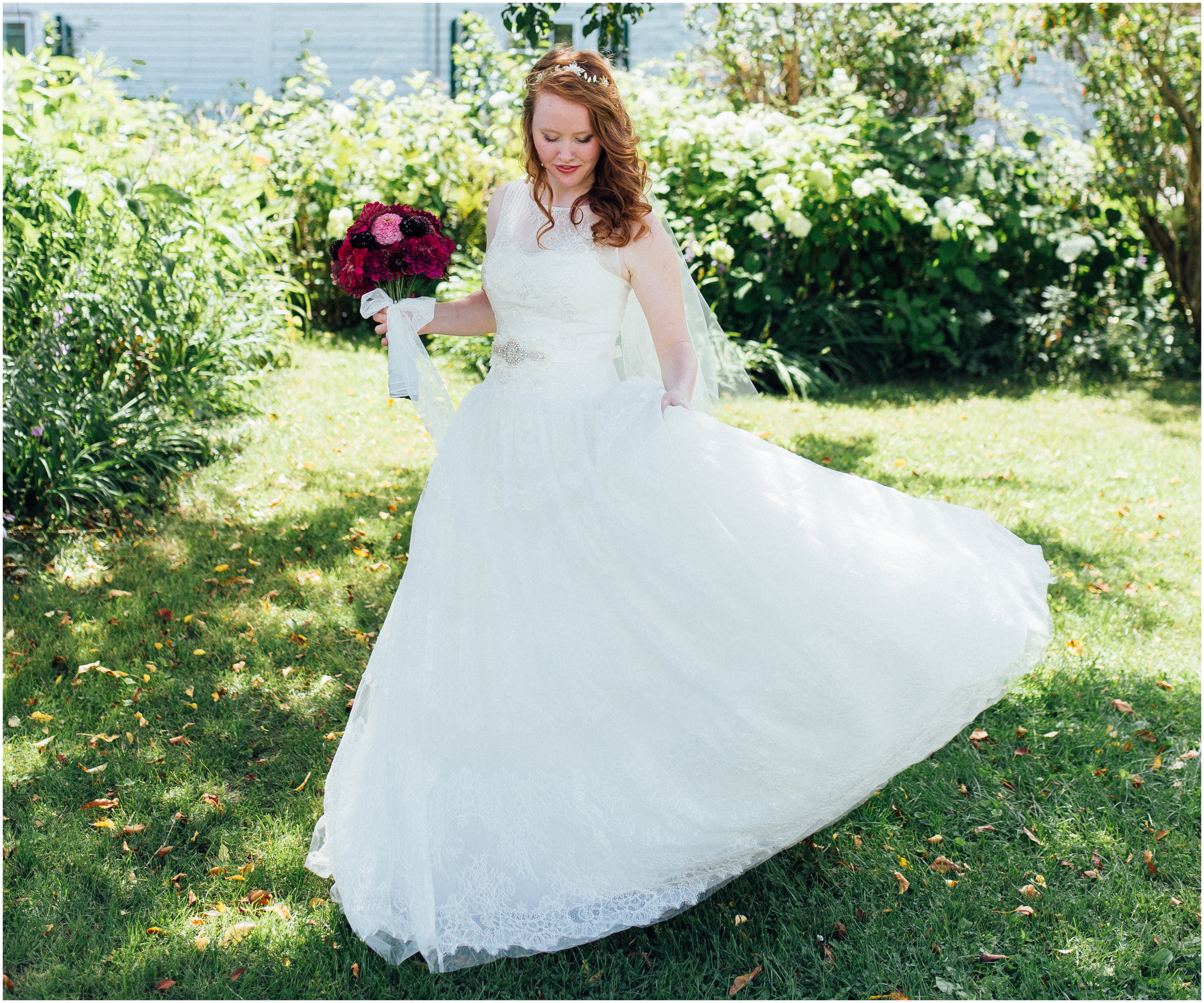 Beautiful bride twirling in her dreamy ballgown wedding dress