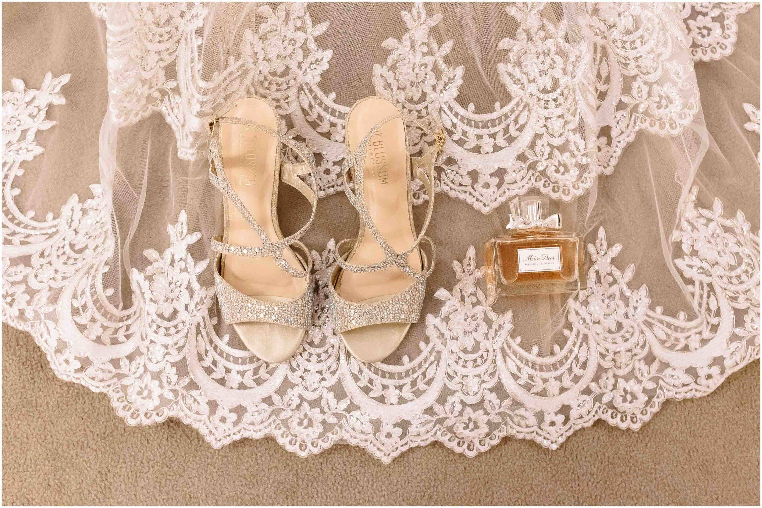 Scenic New Hampshire Wedding at Atkinson Resort and Country Club - Bridal shoes, lace details, and perfume