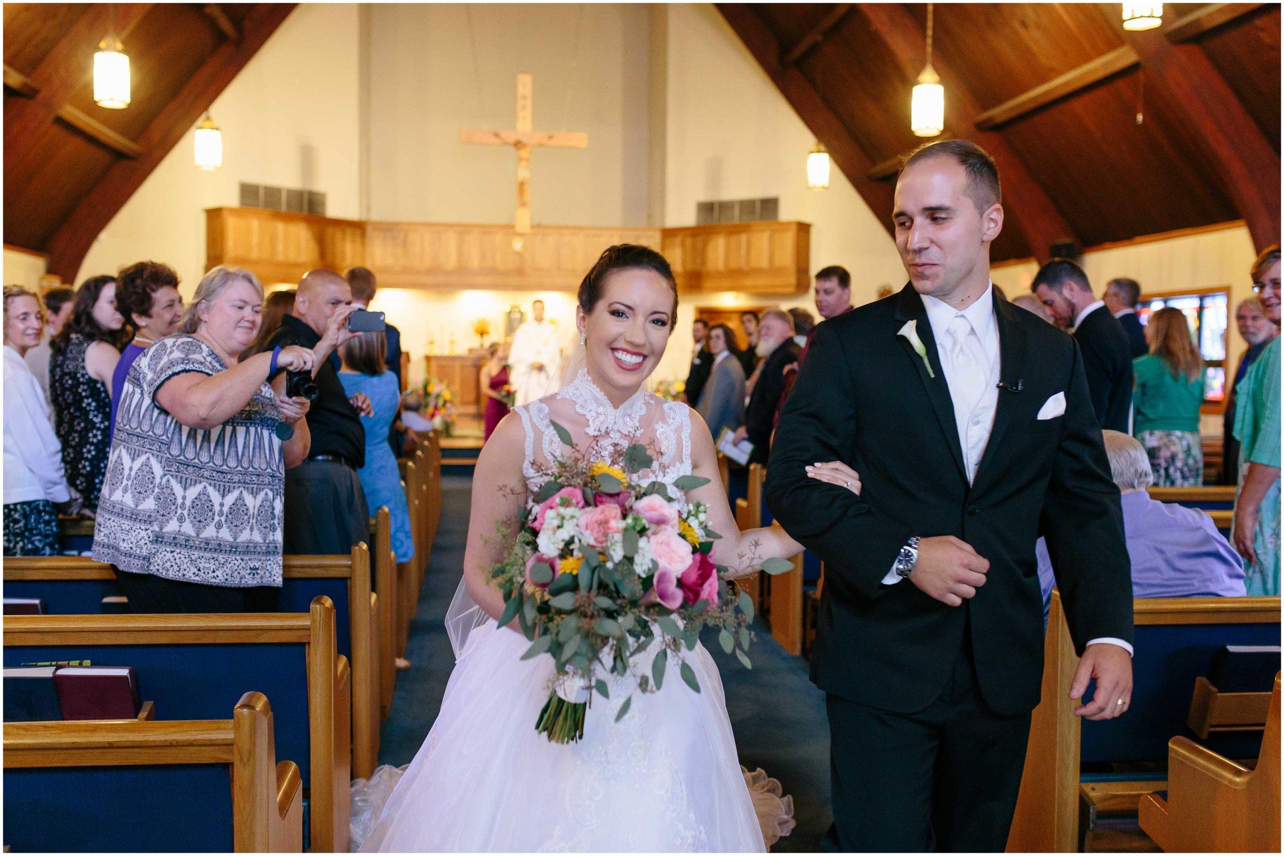 Chic New Hampshire Wedding at Manchester Country Club Bedford - Immaculate Heart of Mary Church bride and groom exit
