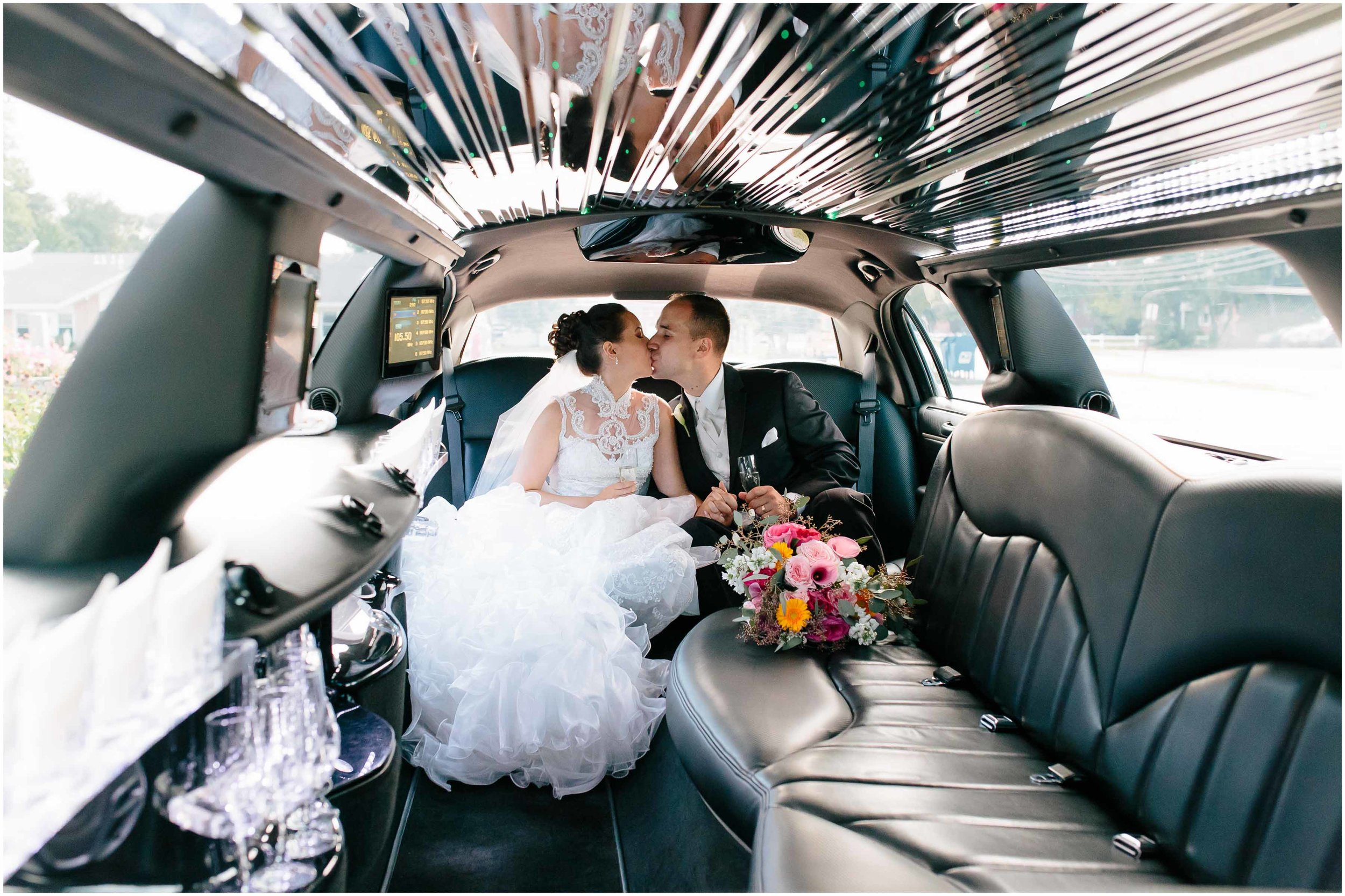Chic New Hampshire Wedding at Manchester Country Club Bedford - brides and groom with champagne and Grace Limousine