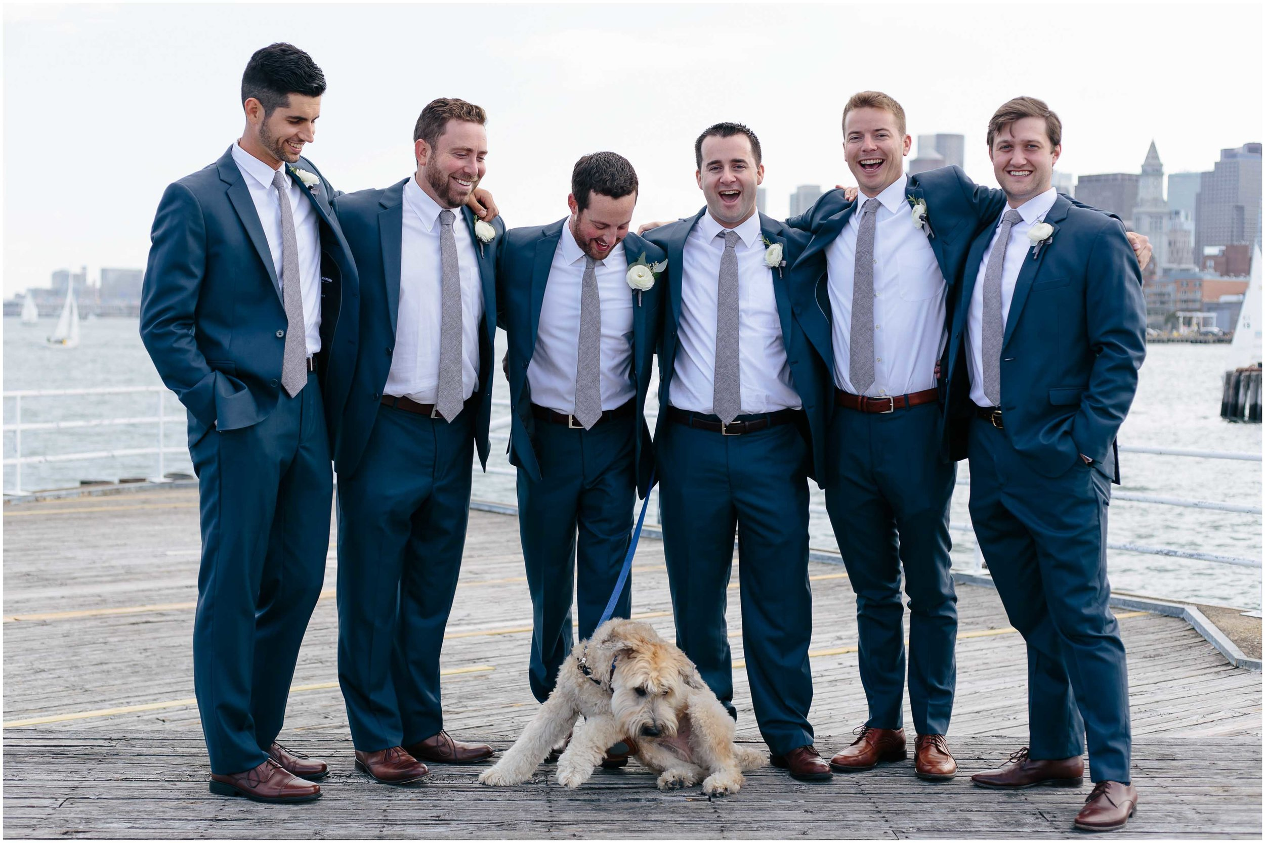 Nautical Massachusetts Jewish Wedding in the Boston Navy Yard laughing groom and groomsmen and dog