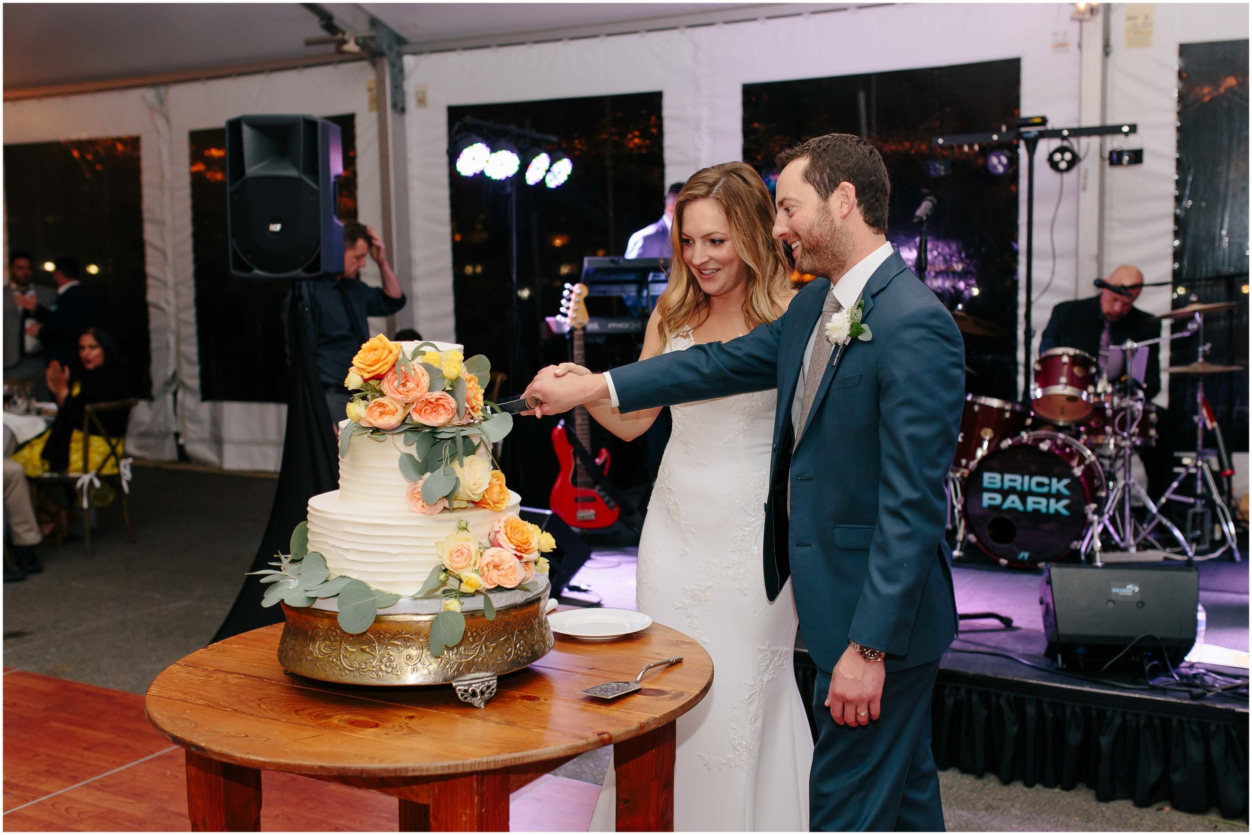 Nautical Massachusetts Jewish Wedding in the Boston Navy Yard reception cutting the cake