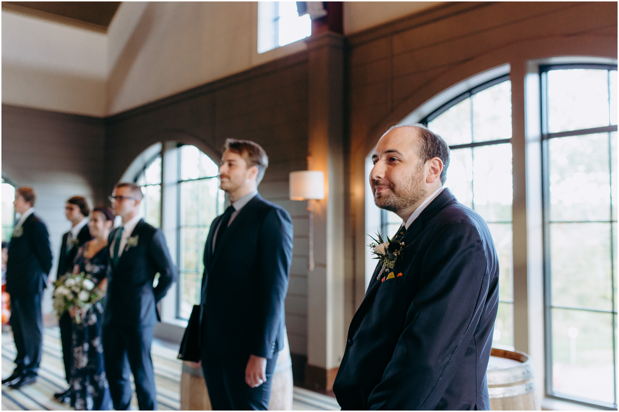 Groom and his groomsmen during ceremony - by Ashleigh Laureen Photography at LaBelle Winery in Amherst, New Hampshire