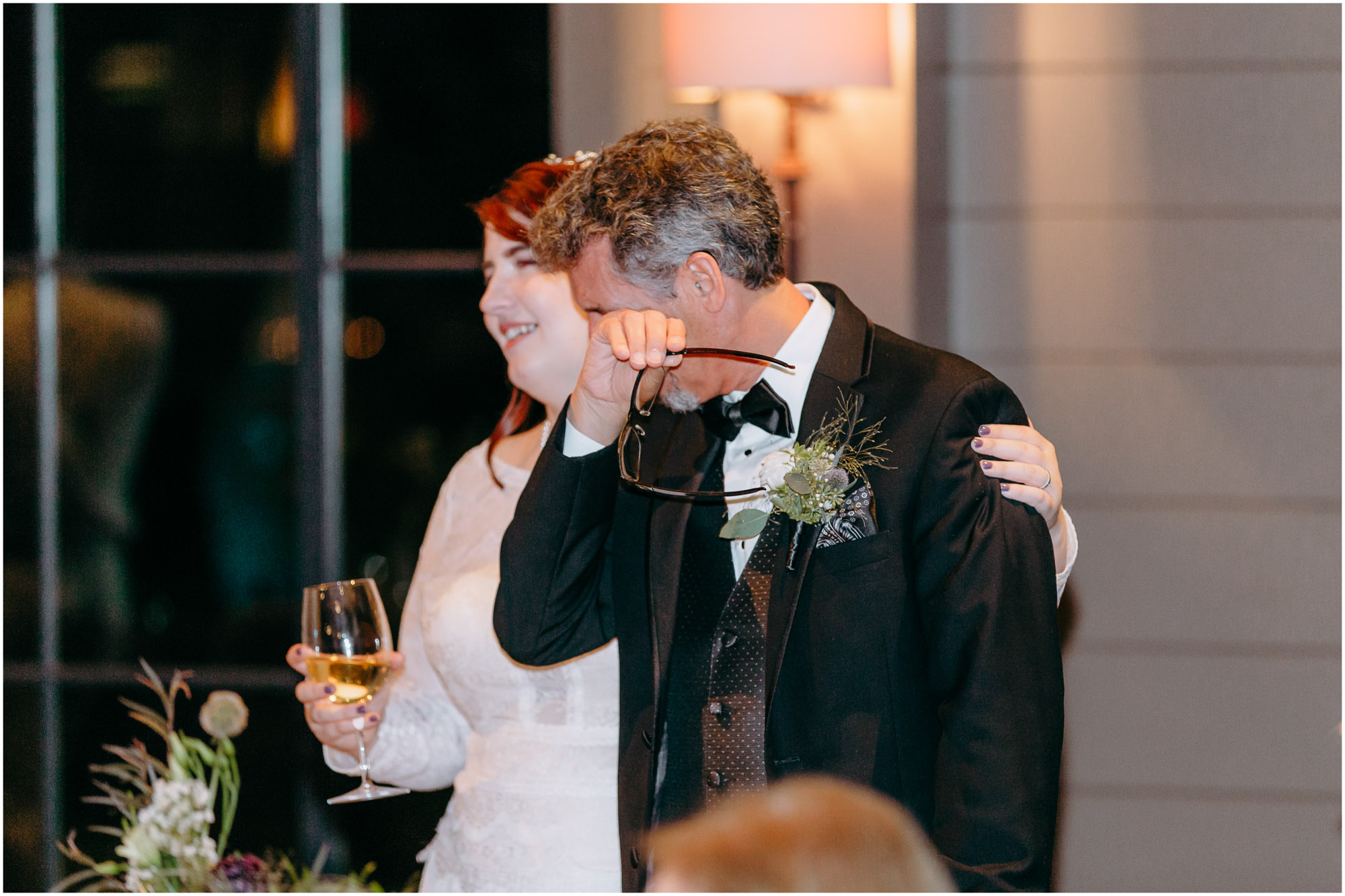Father of the groom cries happy tears and wipes his eyes at reception - by Ashleigh Laureen Photography at LaBelle Winery in Amherst, New Hampshire