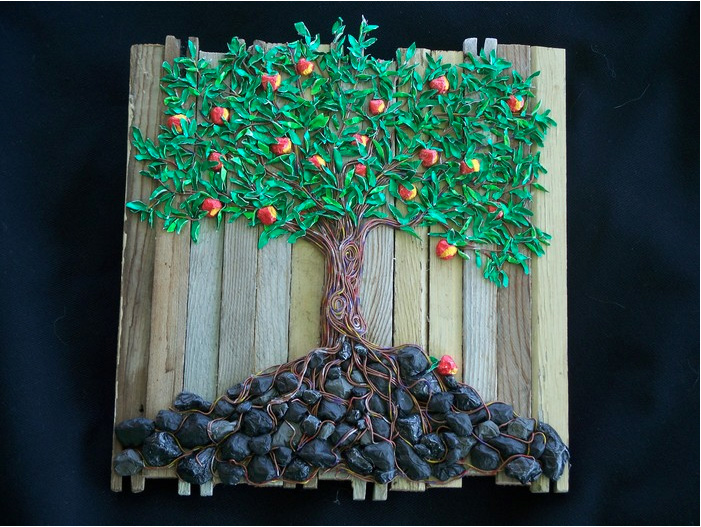 Gail Molina      Gummin' the Apple Tree , 2013     Orchard props, gum wrappers, electrical wire sealer Yakima, WA