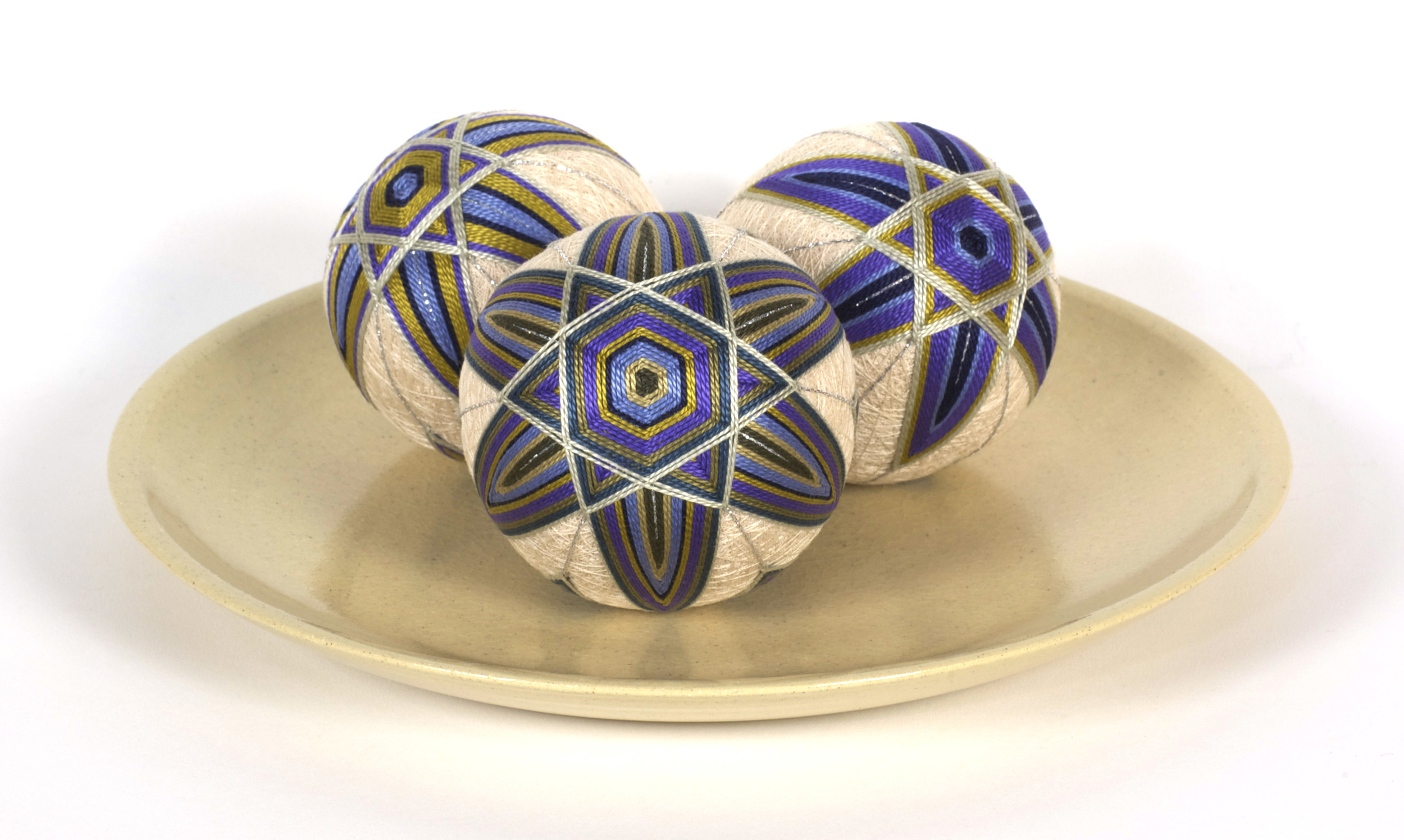 Susan E. Kelly     This Beautiful Path   –   Set of   3   Japanese Temari , 2012  Mixed media (rice hulls, yarn, thread, embroidery thread)