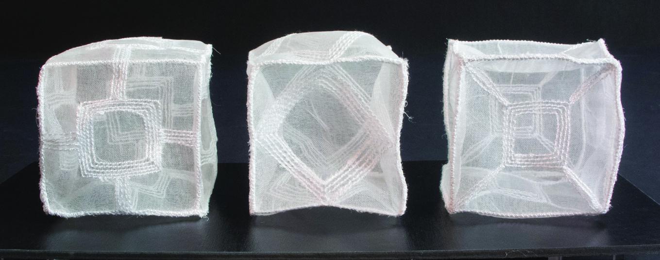 Maura Donegan      1+1+1 , 2014     Silk organza, rayon thread