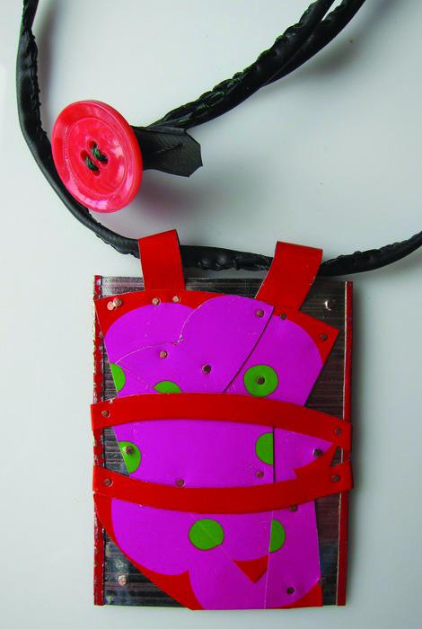 Deborah Paul      Pretty In Pink, 2013     Recycled post-consumer tins, bicycle inner tube