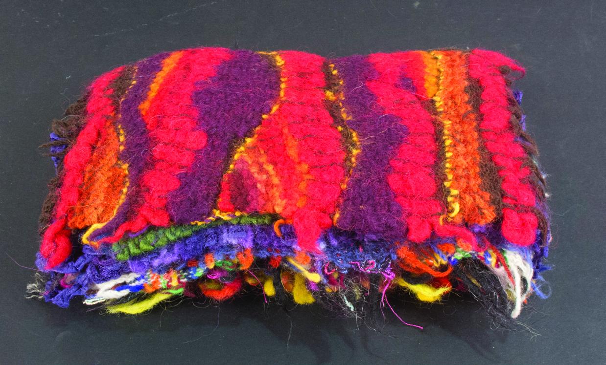 Judy Hurcomb      13 Fantasy Rugs , 2014    Felted wool and cardboard box