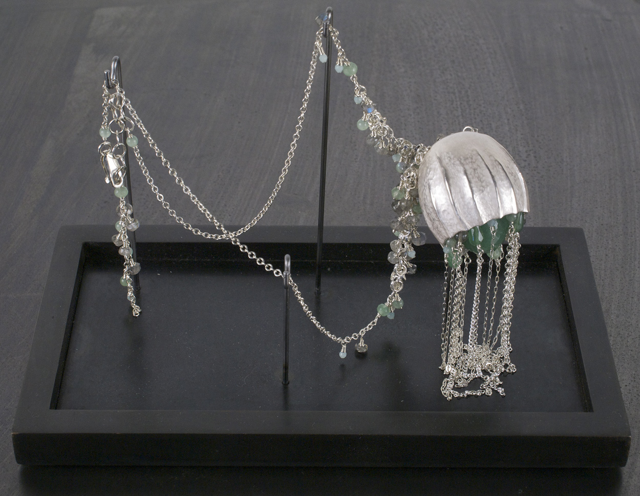 Catherine Grisez   Squirt , 2009  Sterling silver, aventurine, labrodorite, steel base  Courtesy of Traver Gallery