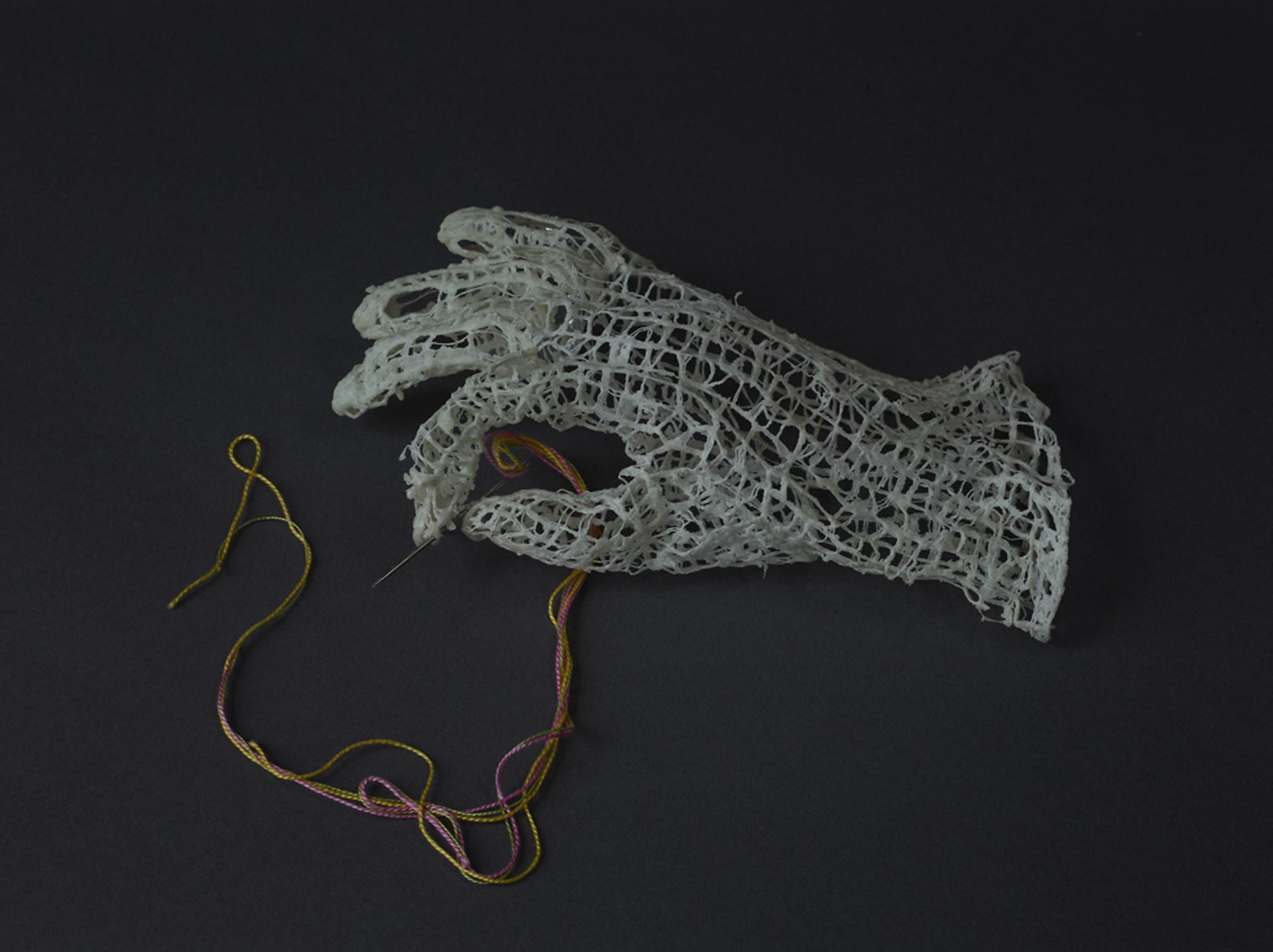 "Maura Donegan  ""Humankind,"" 2015  silk organza, raton thread, wire, needle, perle coton, encau  Issaquah, WA  3""x9""x5""  $1,200"
