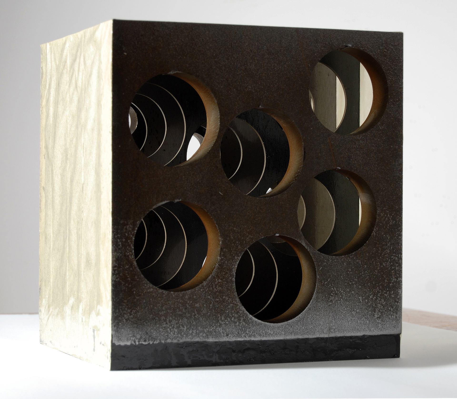 "Annika Newell  ""Series of Holes, no.4,"" 2017  steel, sealed paper, wood, sculpt metal, graphite  Georgetown, WA  10""x9""x8""  $5,000"