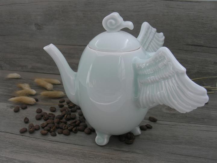 """Sita Wong  """"Fly with Me- Teapot,"""" 2016  celadon porcelain  Kowloon, Hong Kong  16cmx20cmx18cm  $375"""