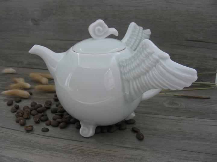 """Sita Wong  """"Fly With Me- Teapot,"""" 2016  celadon porcelain  Kowloon, Hong Kong  13cmx20cmx19cm  $375"""