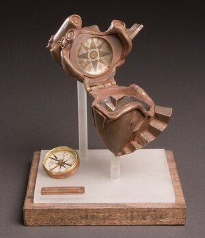 AIMEE HOWARD  CONFUSED HEART, 2006  Bronze, Copper, Silver, Nickel, Acrylic, Wood, Found Object  Edwardsville, IL