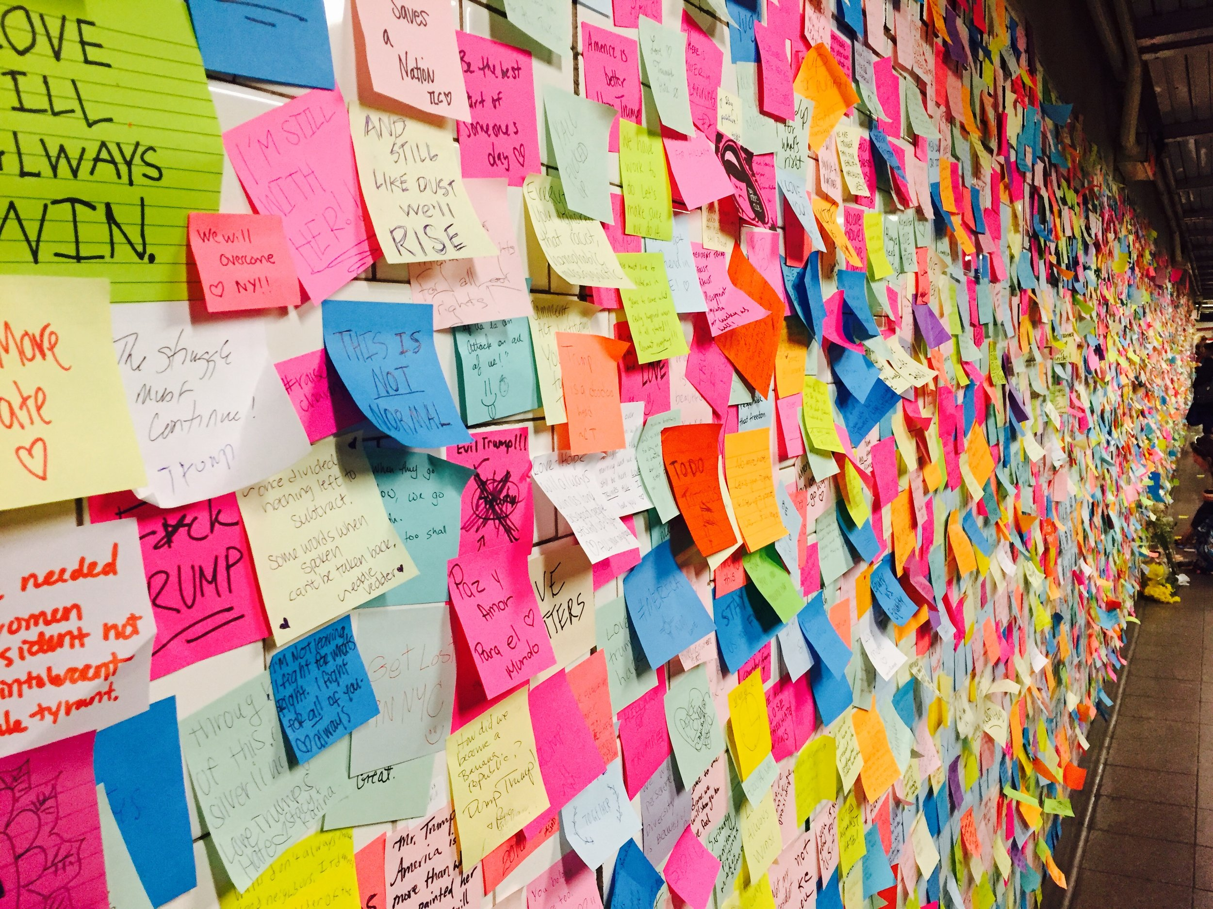 """This Is How You Build a Wall:"" A picture of the thousands of Post-It Notes in Union Square Subway Station, calling for No Hate,"