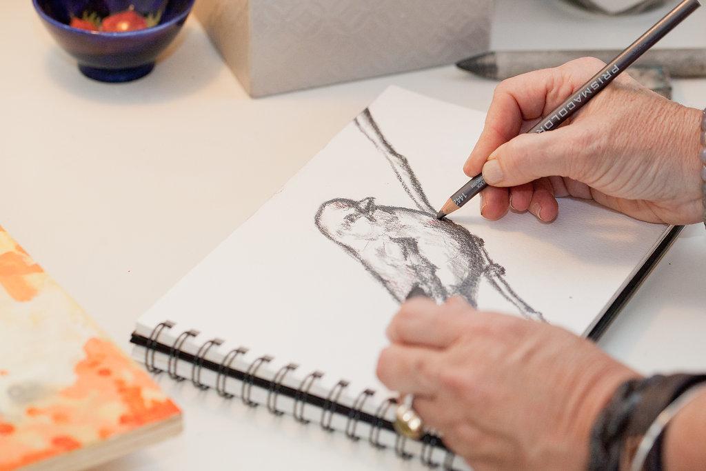 drawing bird in sketchbook.jpg