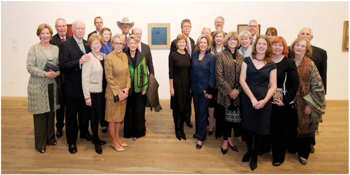 "OJAC Board Members, Staff, and Friends with collection piece, 'Der Weg Ins Blaue"" by Paul Klee at the Tate Modern in London for the opening of 'Paul Klee-Making Visible', 2013."