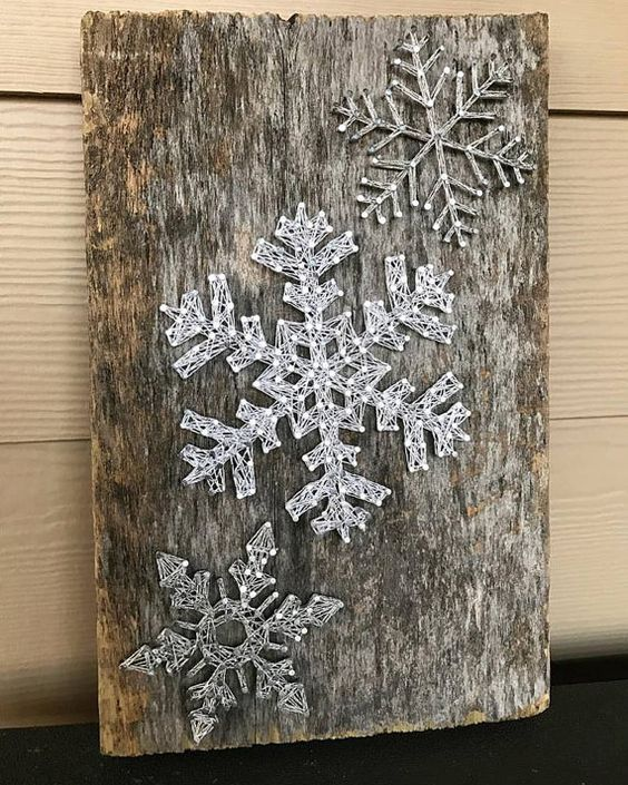 03-a-reclaimed-wood-piece-with-string-art-silver-snowflakes-looks-very-cool.jpg