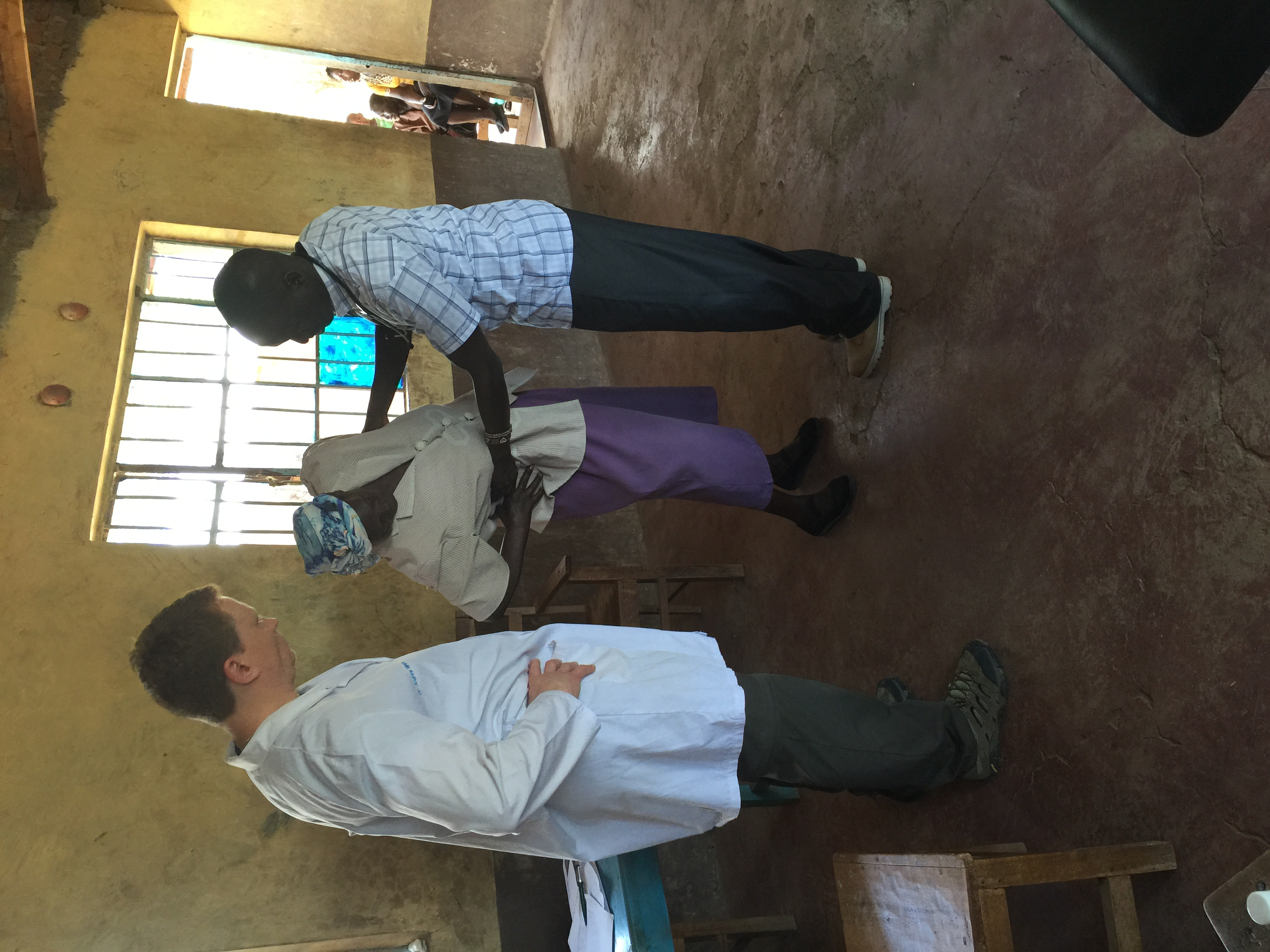 Dr. Miners and Samuel with a patient
