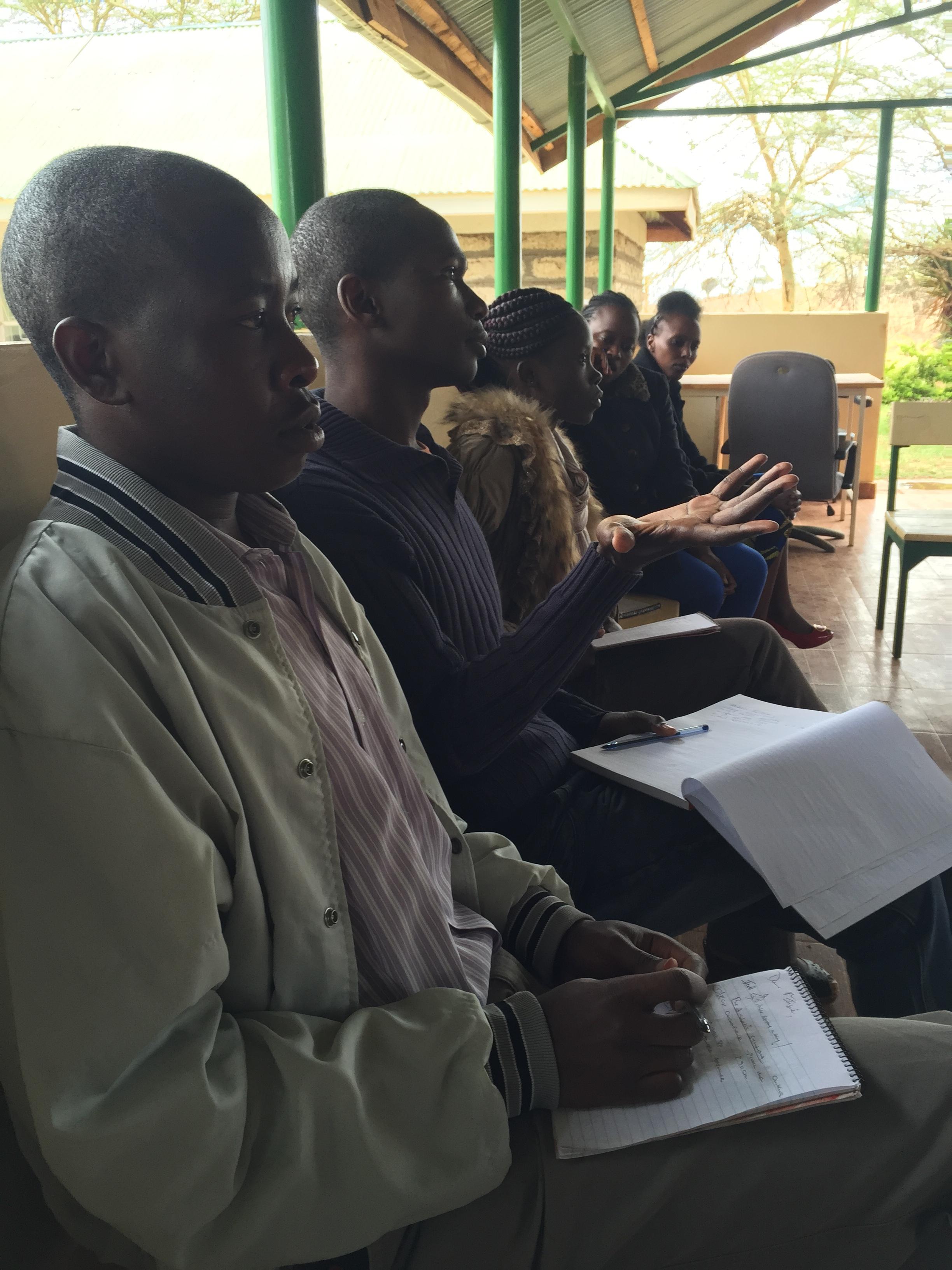Geoffrey, one of Lewa's nurses asking Dr. Michael a question.
