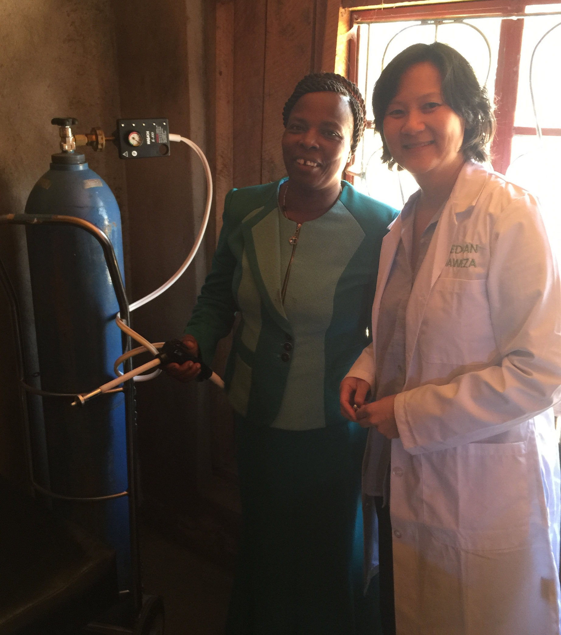 Dr. Sue and Cecilia, the government nurse, standing next to the cryotherapy unit, which is used to remove minor lesions on the cervix.