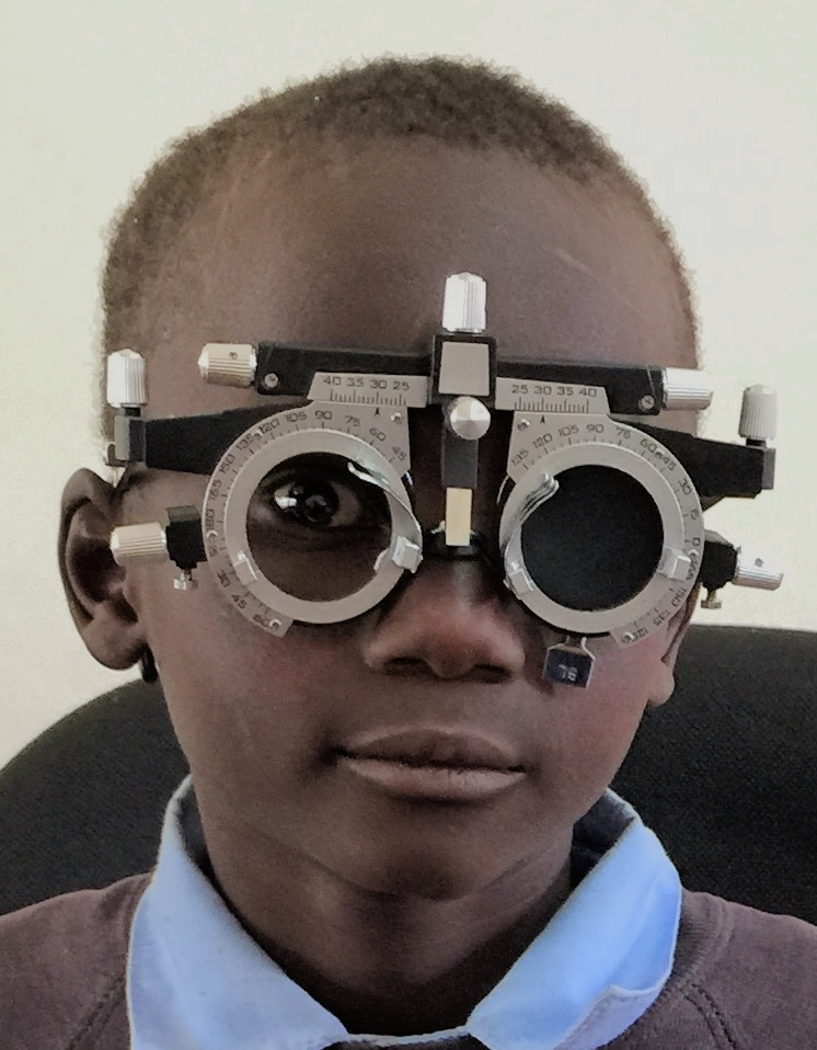 A little boy being measured for prescription glasses. We screened 50 children during a school vision clinic and identified 4 that required glasses. Naweza will provide the glasses for the children. Lewa and Naweza will continue to do the school screenings and will partner in funding any eye wear required.