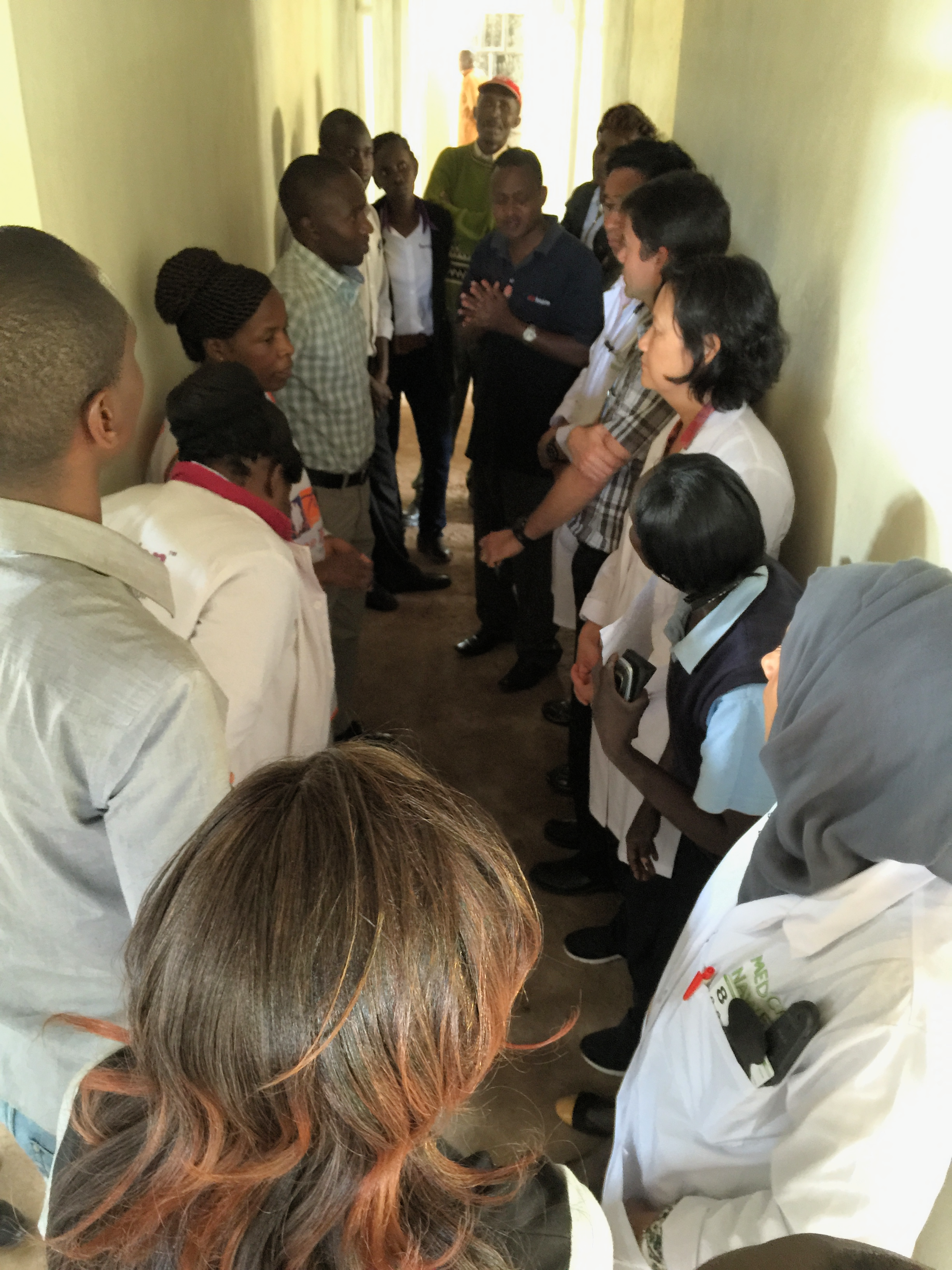 A meeting of the Medcan Naweza staff to discuss crowd control. There will be over 300 visits today and managing the queues will be a logistical challenge.