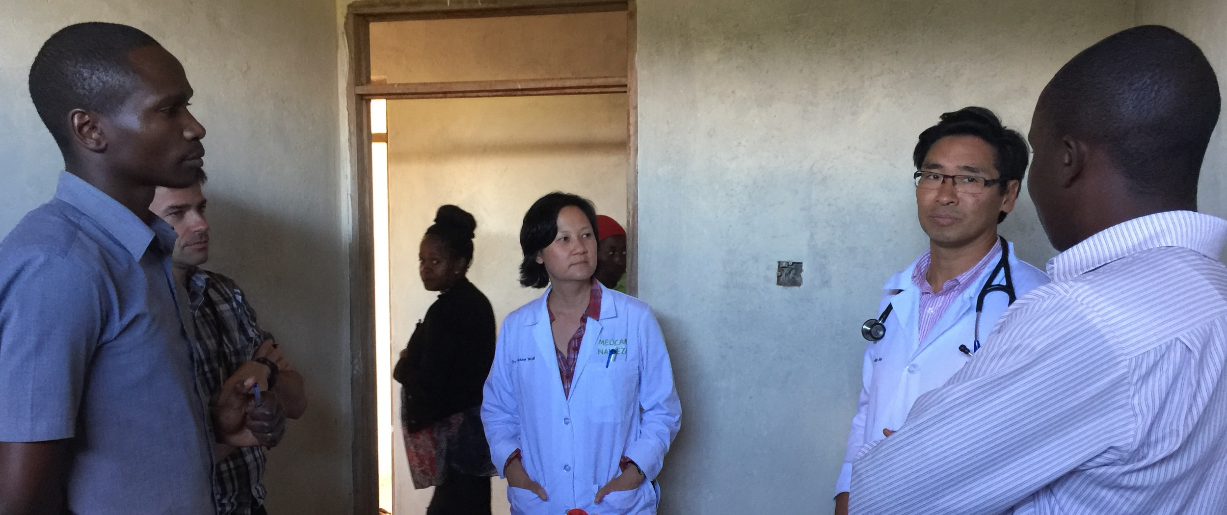 Dr. Michael, Dr. Sue and Dr. James consulting with each other and the Lewa staff to diagnose a patient.