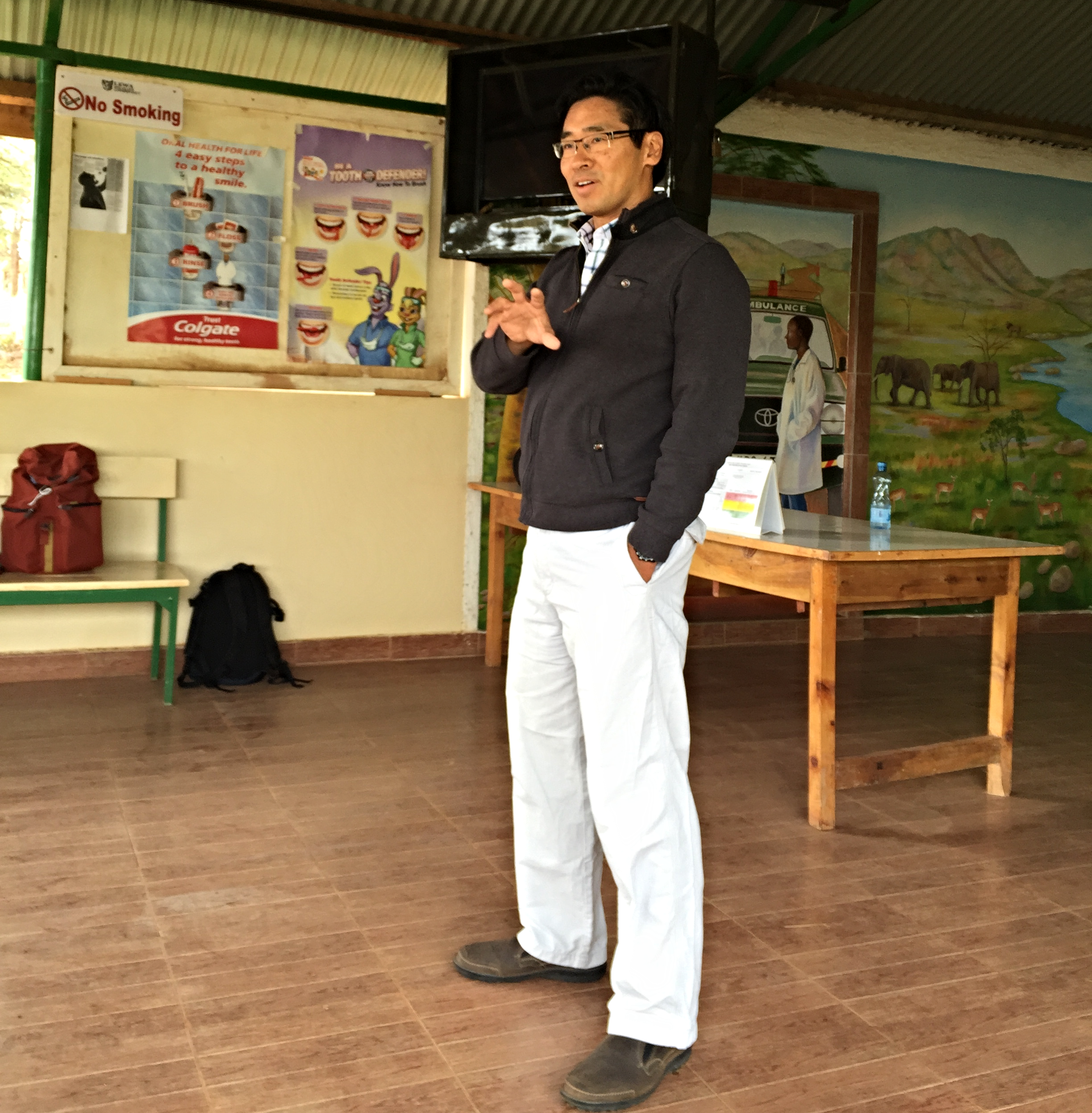 Dr. James giving a talk on chronic disease, which included a review of the World Health Organization's guidelines.