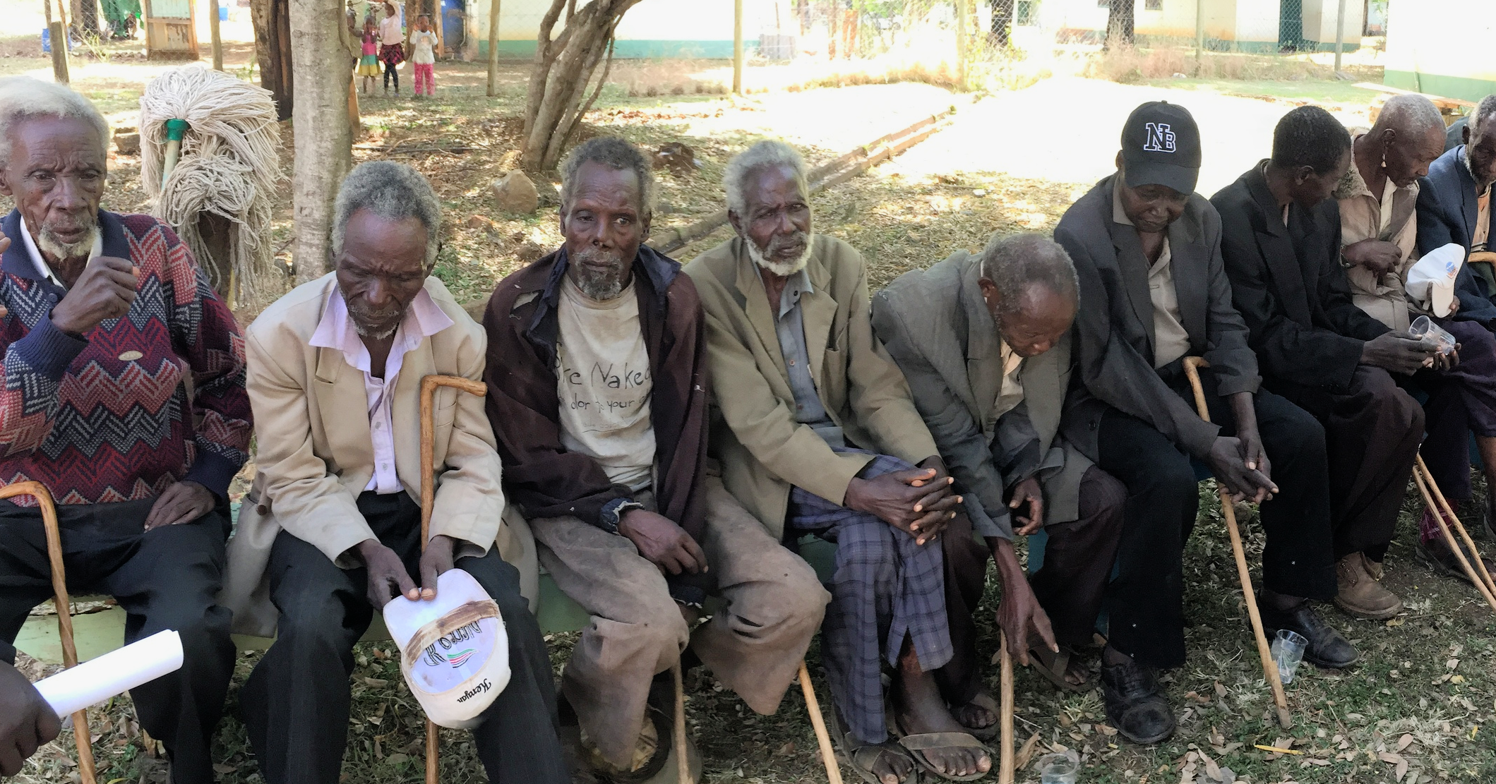 Cataract surgery patients lined up waiting to have their post-op check-up.
