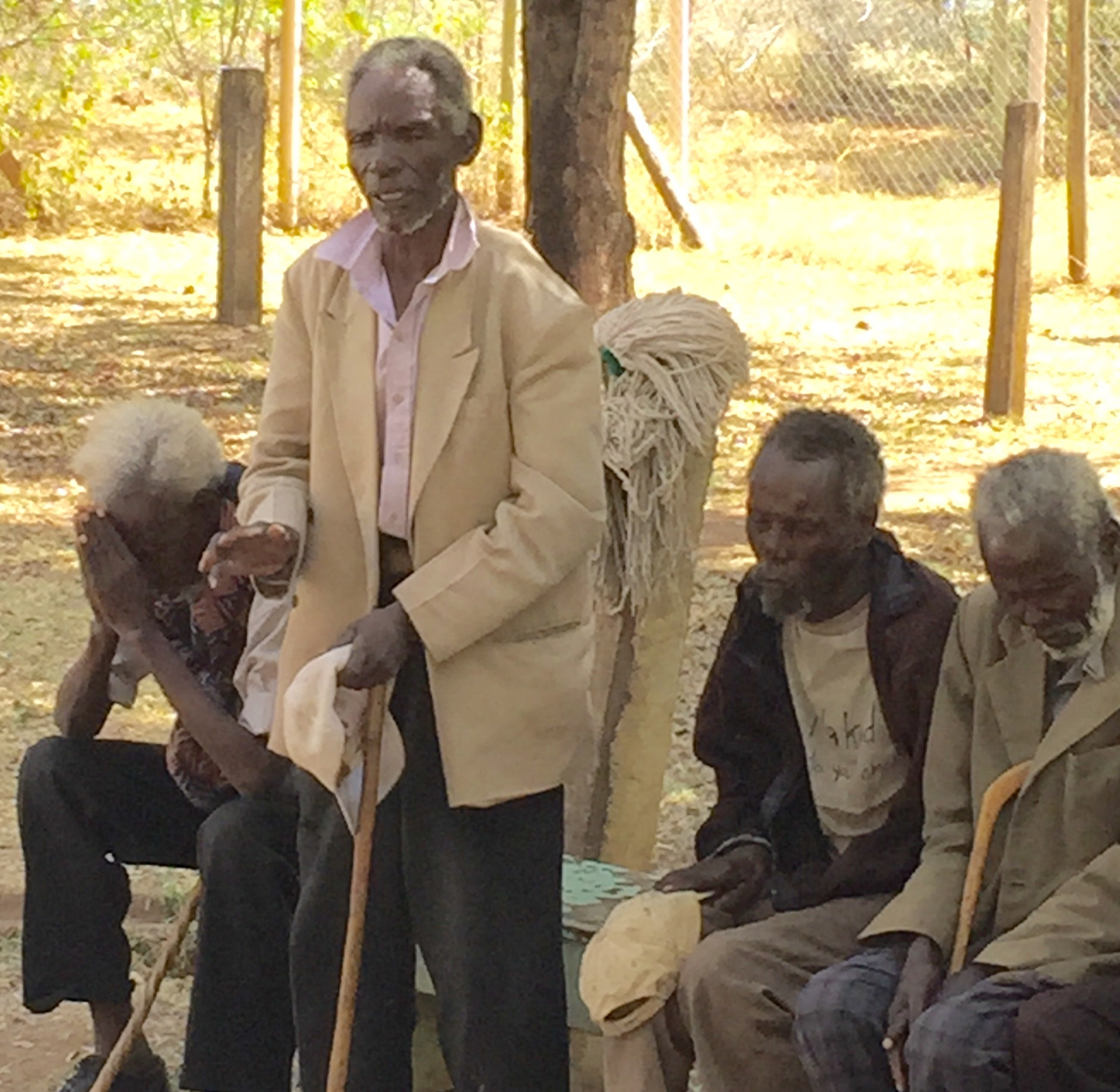 A cataract patient leads a prayer giving thanks for all of their blessings.