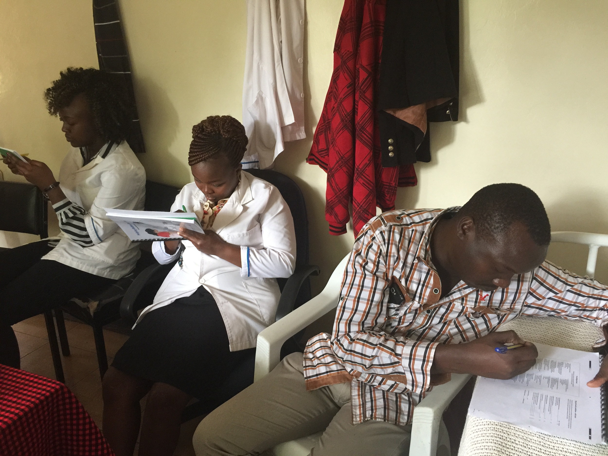 The Fluorspar staff taking a pre-test for the Helping Babies Breathe course taught by Dr. Michael.