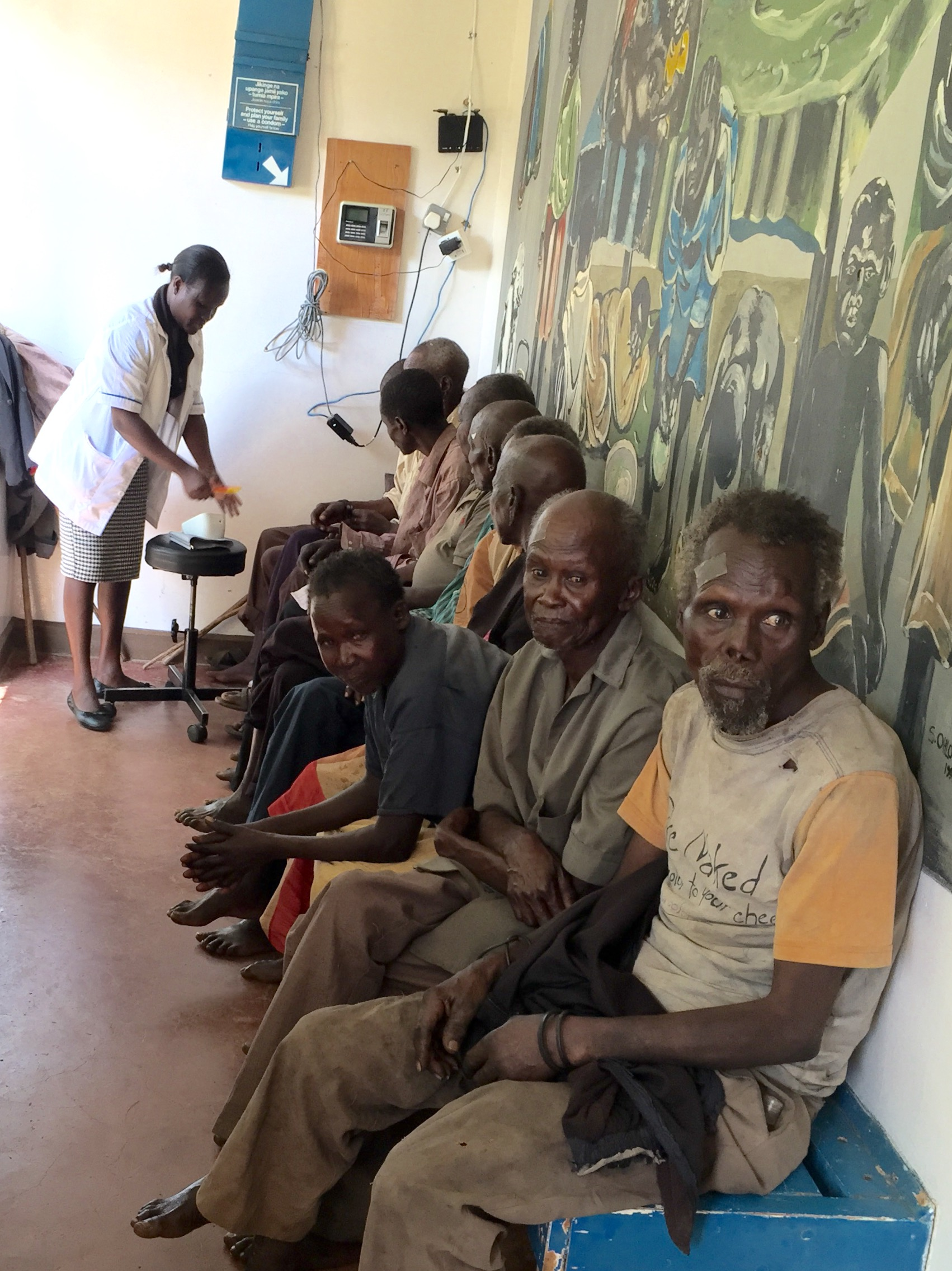 The cataract patients lined up waiting to be prepped for the procedure.