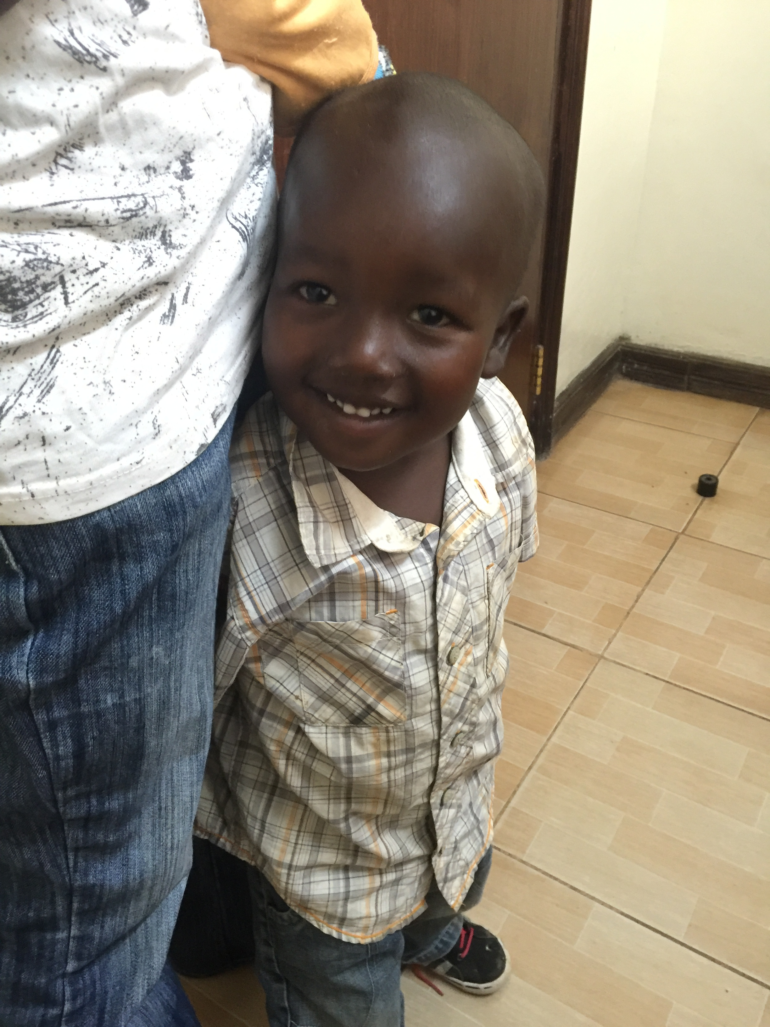 A young patient smiling after care. Another family including a mother and her infant were treated for dehydration.