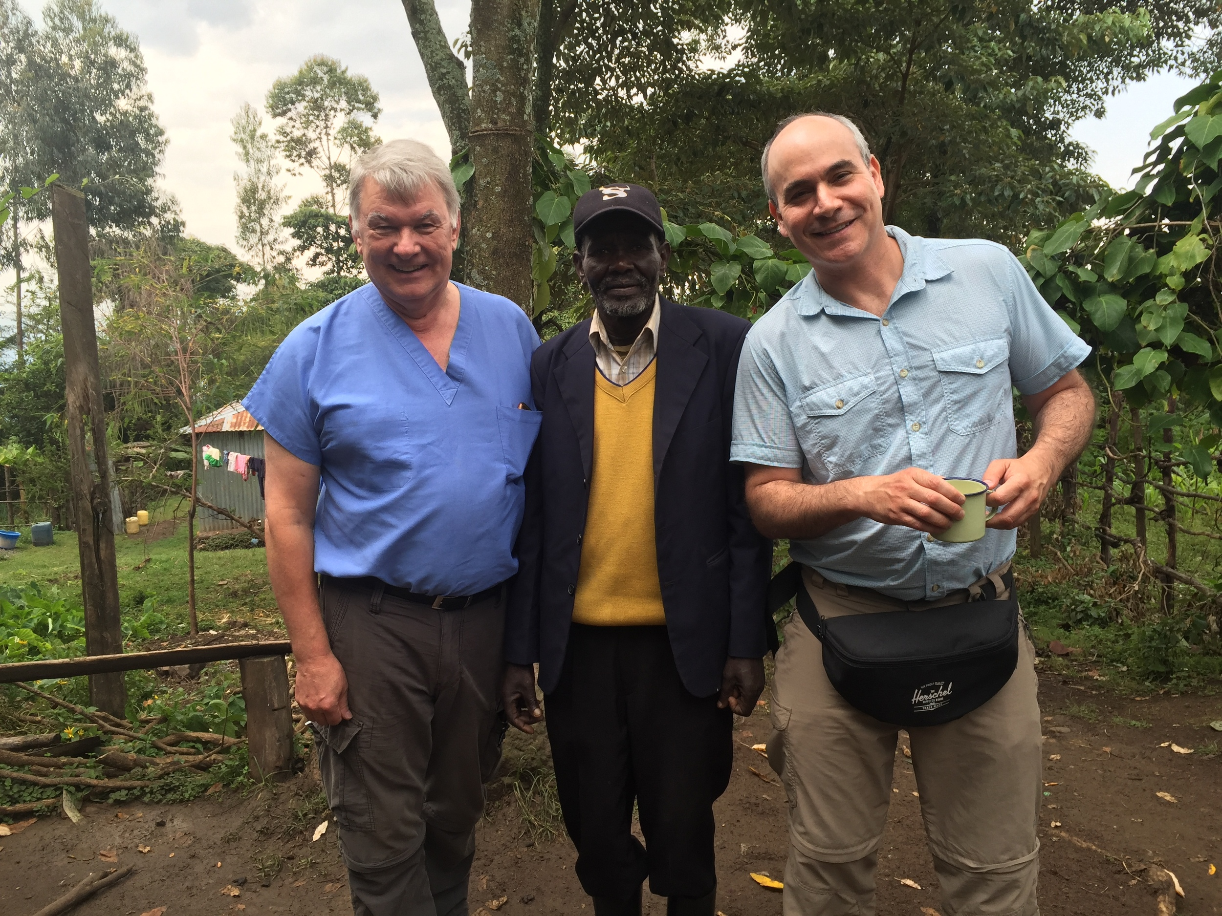 Dr. Ed and Dr. Paul with the village chief whose house we are using to see patients.
