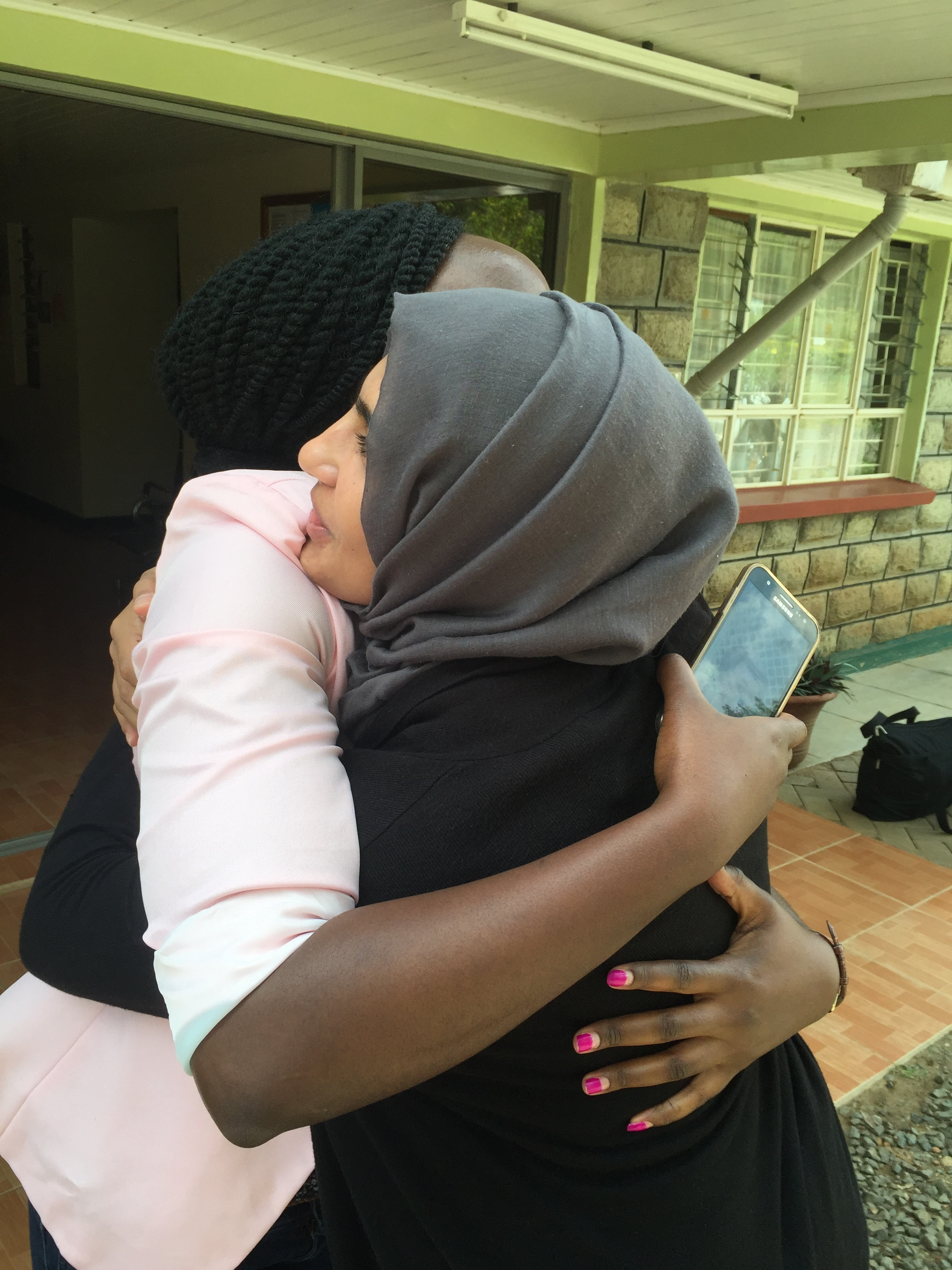 """Jemimah and Dr. Sidiqa saying a sad goodbye. They've worked together very closely over the last 2 years as Jemimah was being trained by Sidiqa to be the """"optometrist"""" at the clinic."""