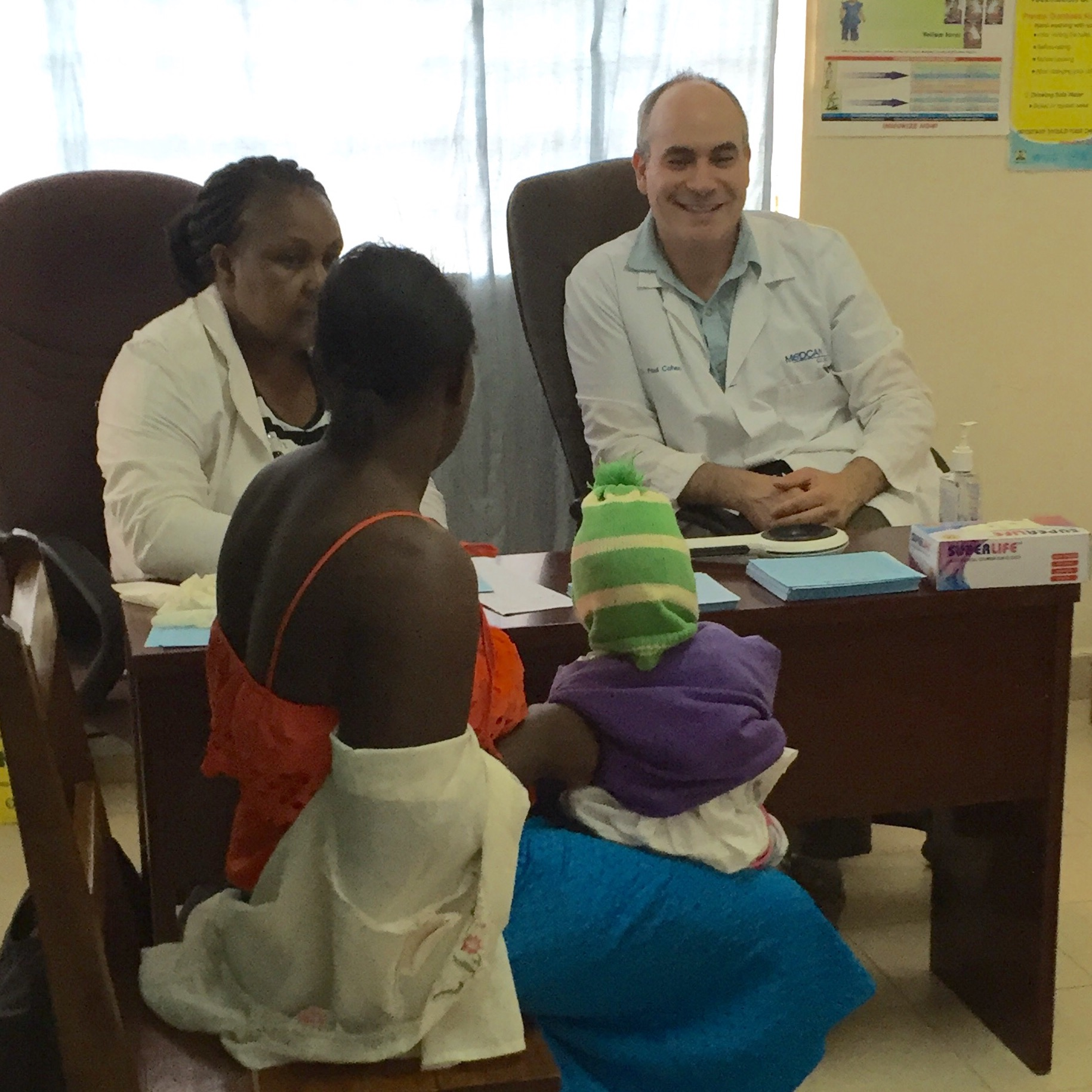 Dr. Paul and Faith seeing a patient at the outreach.