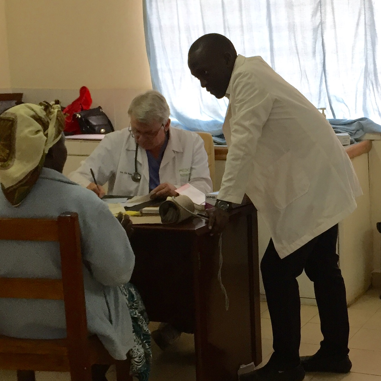 Dr. Ed and Hagai seeing a patient at the clinic