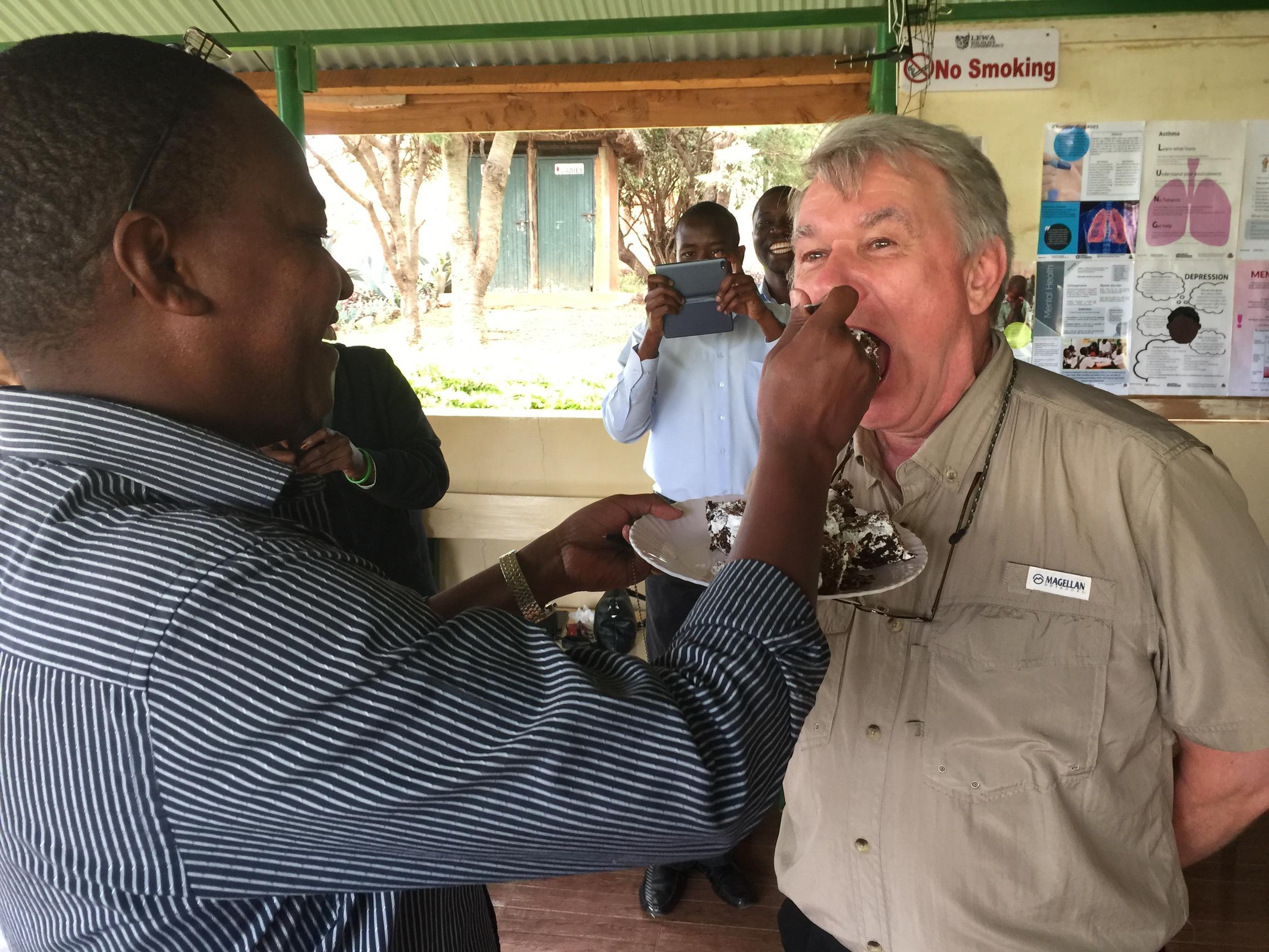 Dr. Ed being fed by Ezekiel