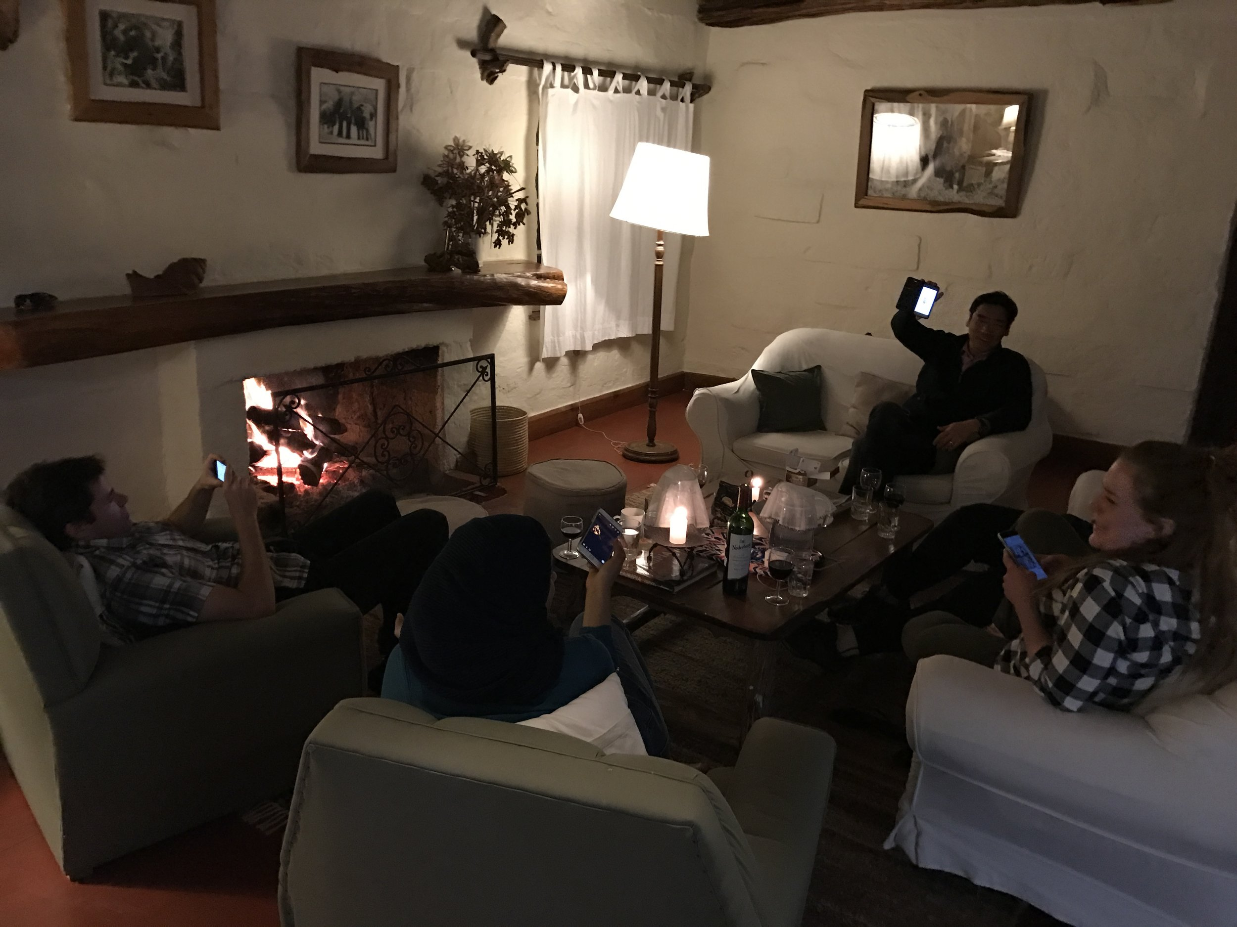 Sharing photos around the fire after dinner.